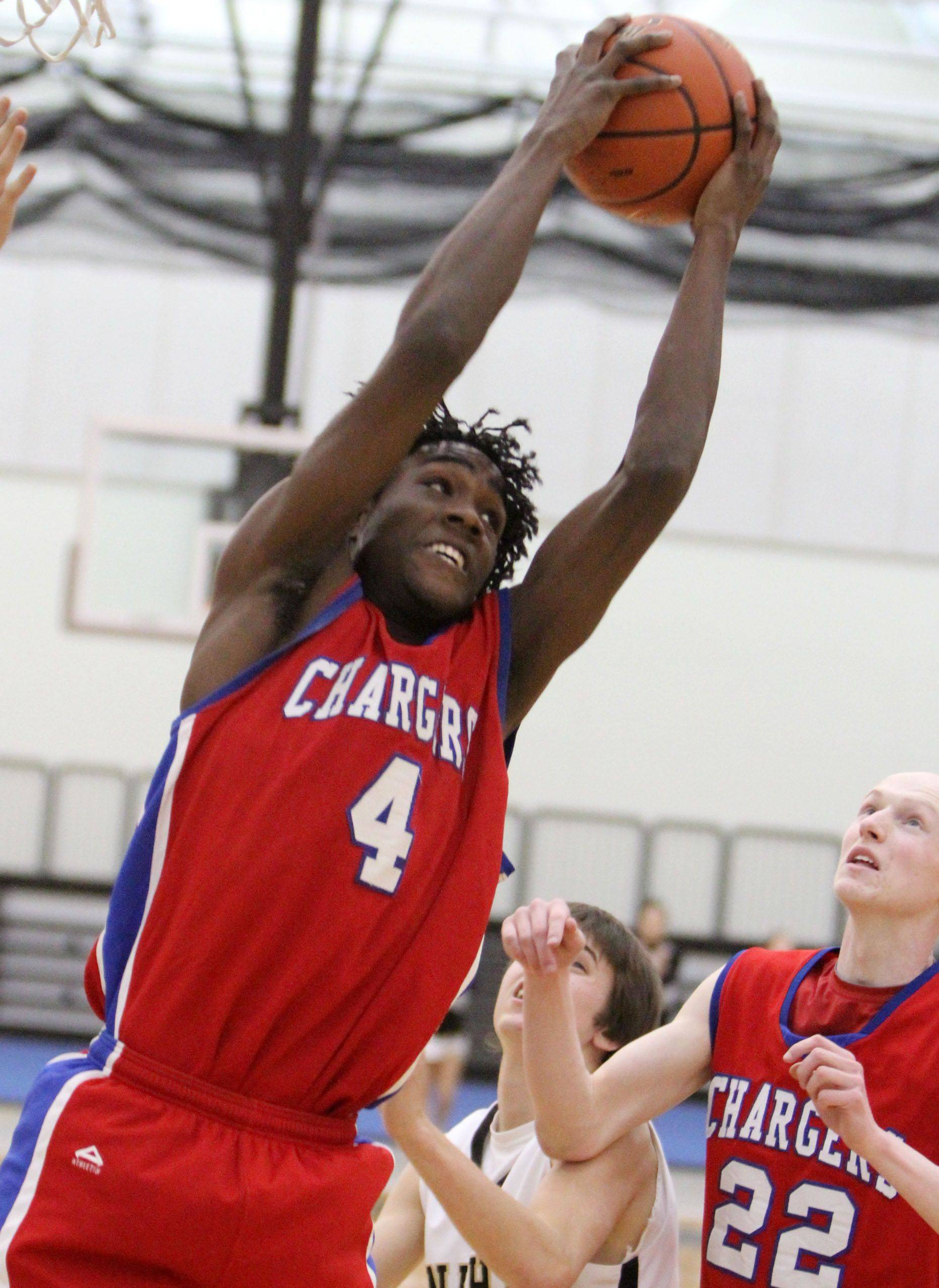 Dundee-Crown's Jamel Kimbrough pulls down a rebound against Grayslake North Friday in Grayslake.