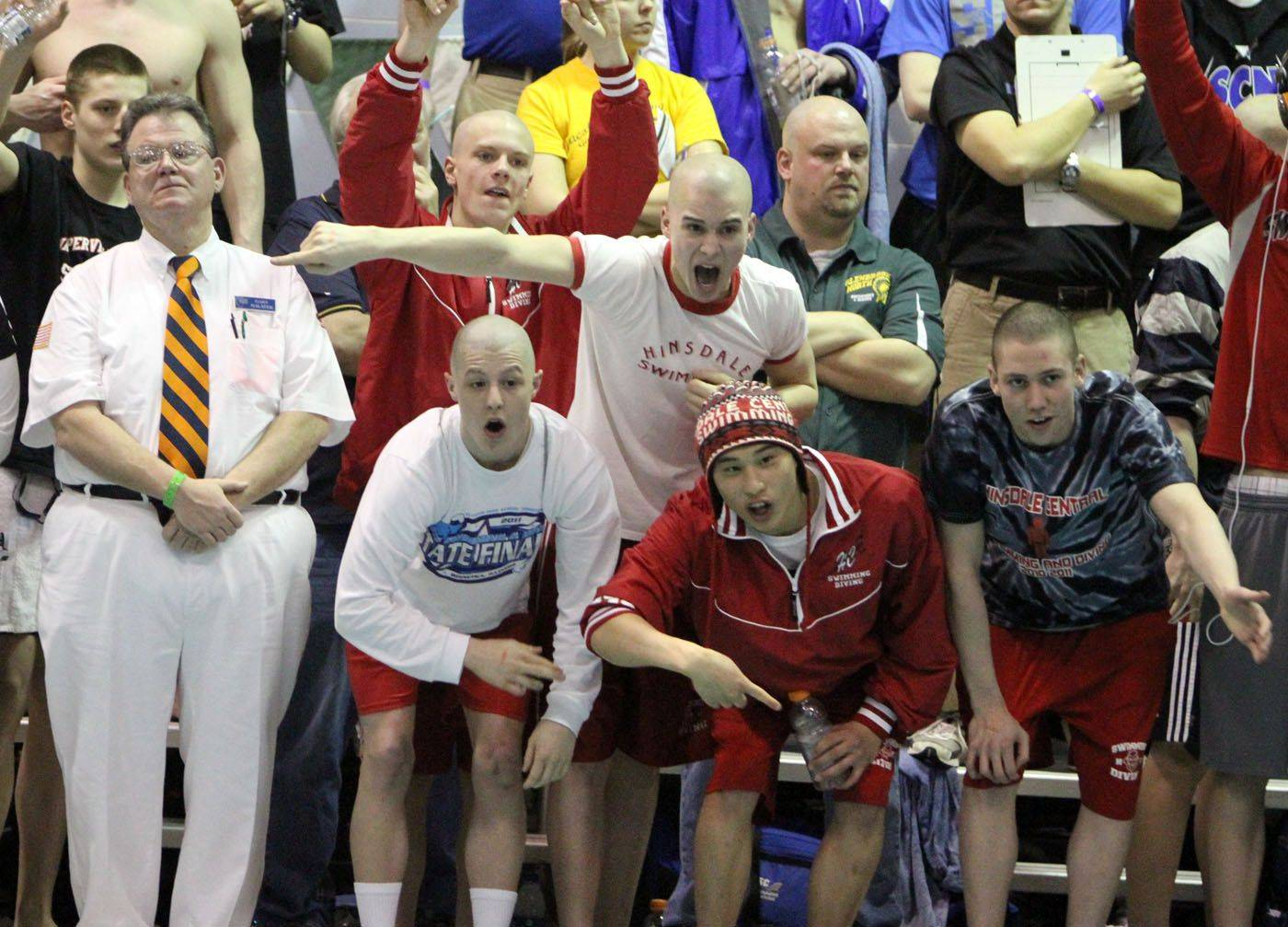 Hinsdale Central teammates cheer for Danny Thomson as he breaks the state record in the 500-yard freestyle at the boys swimming IHSA state championship finals Winnetka on Saturday.