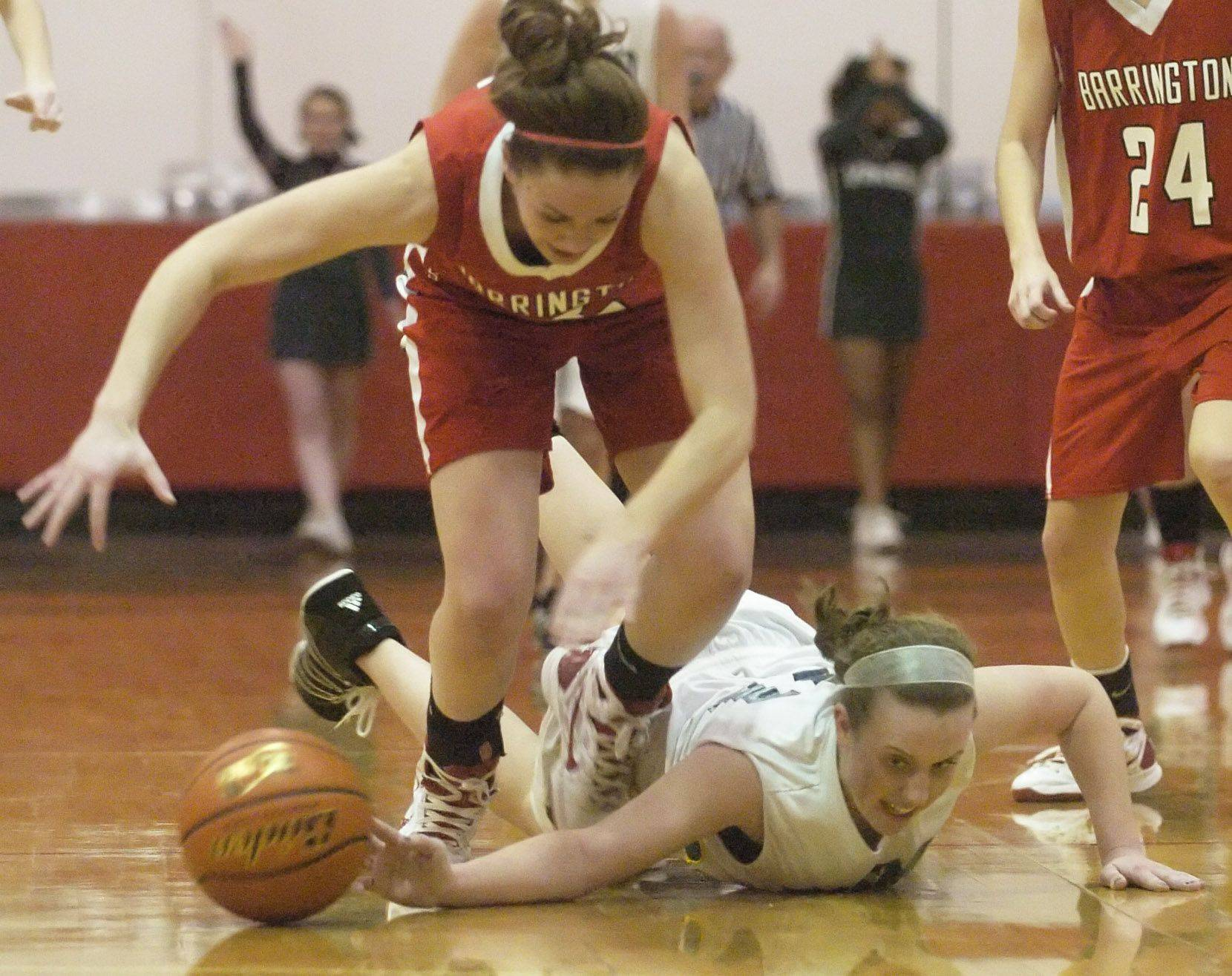 Fremd's Sarah Power, right, dives to knock a loose ball away from Barrington's Sarah Mass during the sectional semifinal at Mundelein Tuesday.