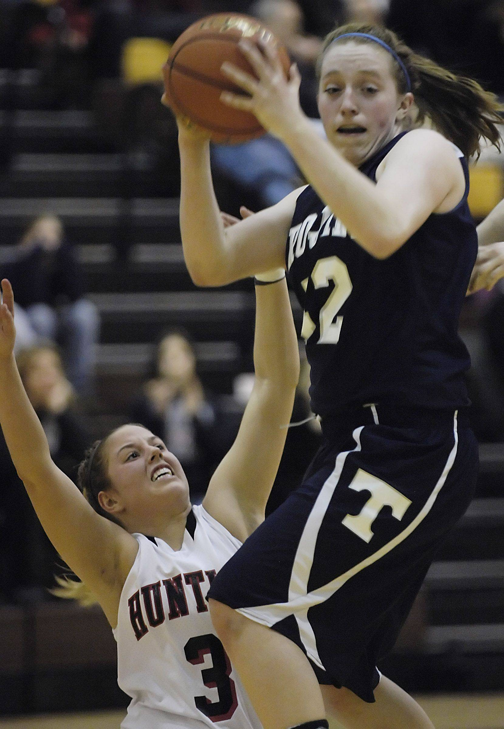 Huntley's Rachel Chapuis defends Cary-Grove's Oliva Jakubicek during Tuesday's sectional game in Algonquin.