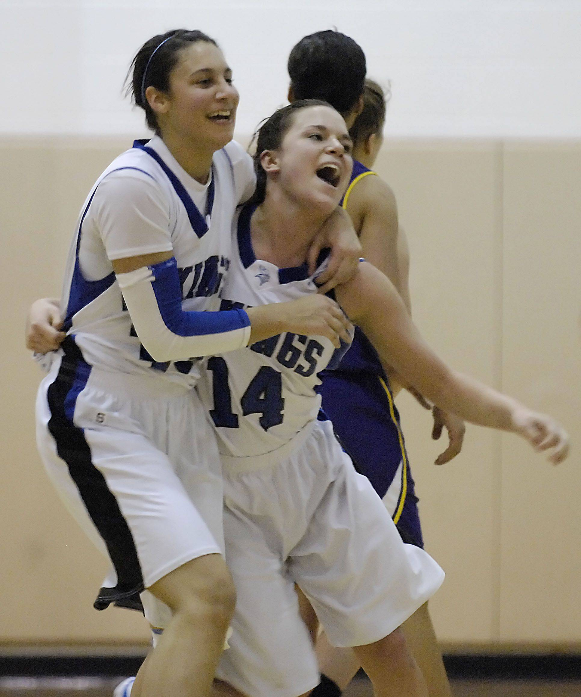 Geneva's Ashley Santos and Kat Yelle laugh after defeating Hononegah Tuesday in the sectional semifinal game in Algonquin.