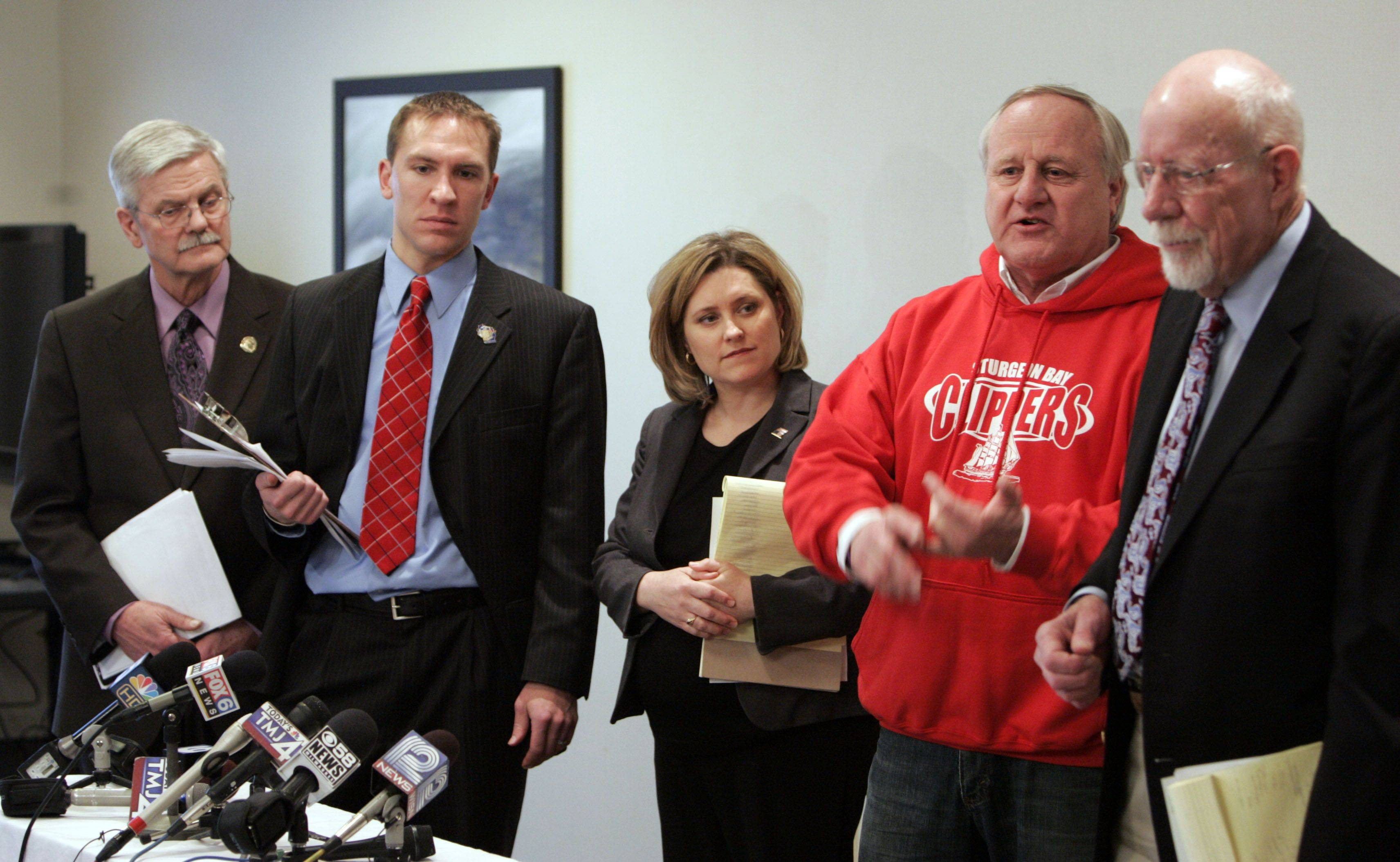 Nomadic Wisconsin state senators Mark Miller, left, Chris Larson, Julie Lassa Dave Hansen and Fred Risser address the media at the Comfort Suites in Grayslake after Gov. Scott Walker's speech Tuesday.