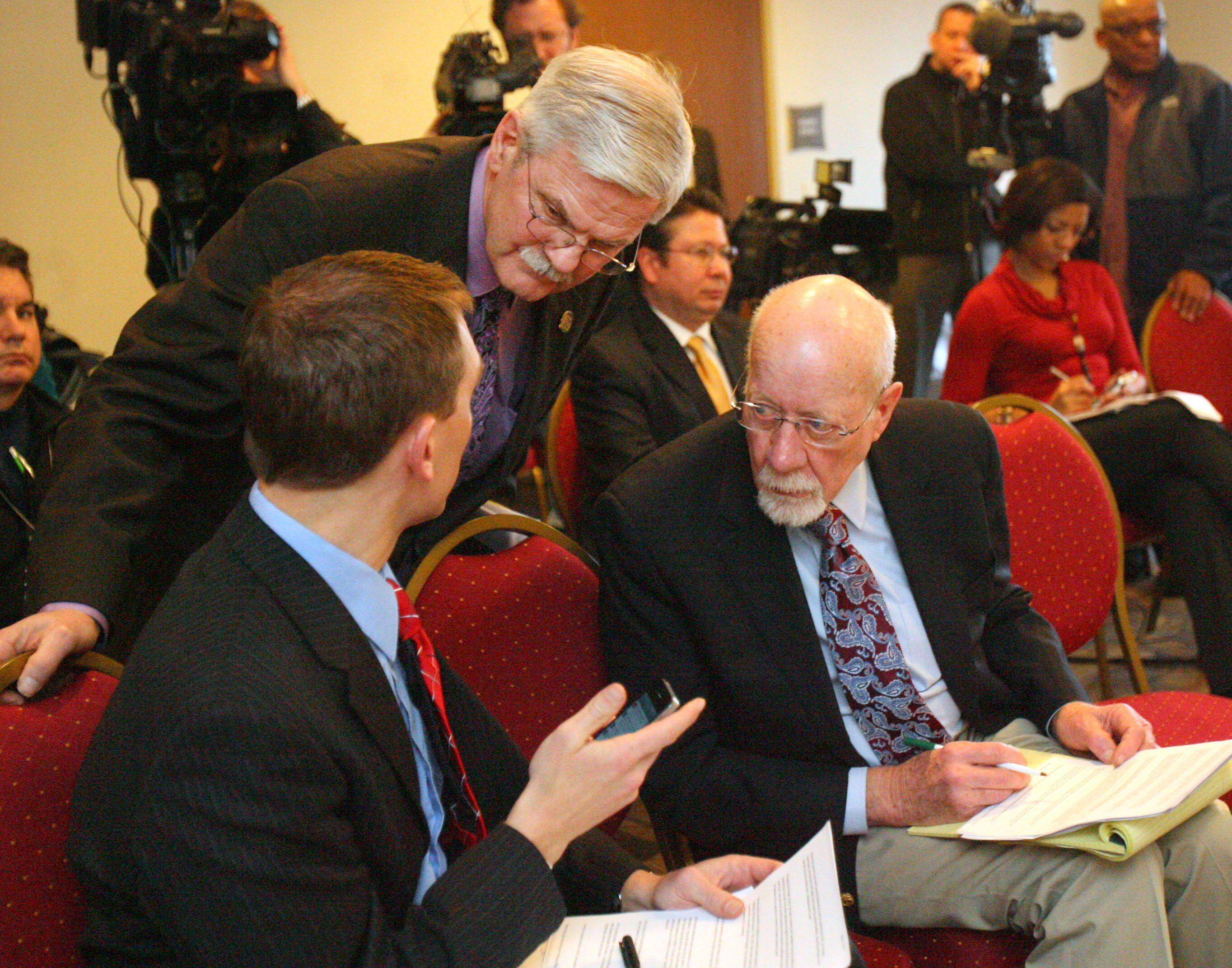 Wisconsin state senators, Chris Larson, left, Mark Miller and Fred Risser chat during Gov. Scott Walker's speech. Five runaway Wisconsin senators watched their governor Tuesday Comfort Suites in Grayslake.