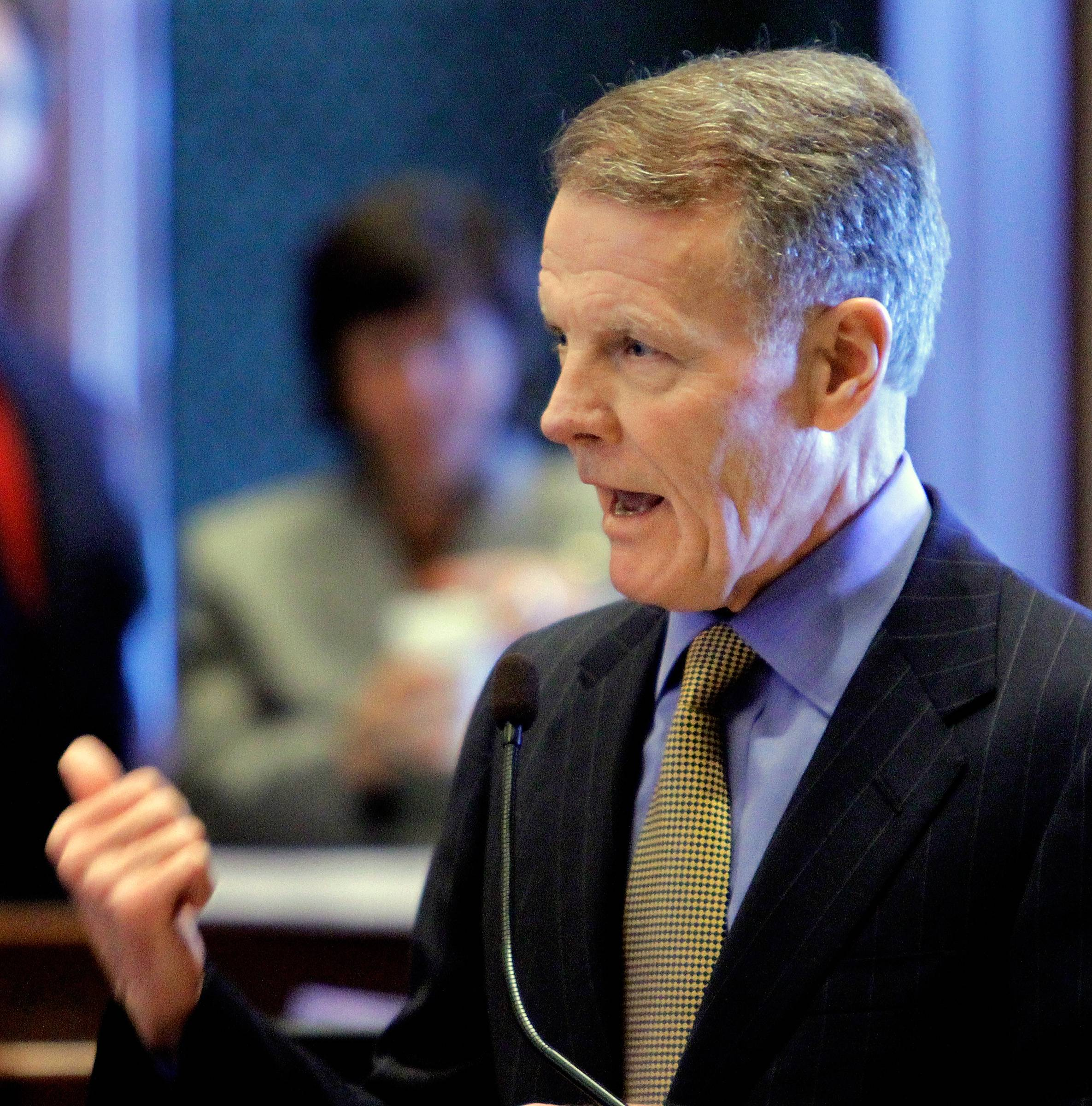 In this Feb, 8, 2011 photo, Illinois Speaker of the House Michael Madigan, a Chicago Democrat, warns lawmakers of tough decisions that lie ahead and even suggested cutting pension benefits for current state employees, a move generally considered unconstitutional, while on the House floor during session at the Illinois State Capitol in Springfield.