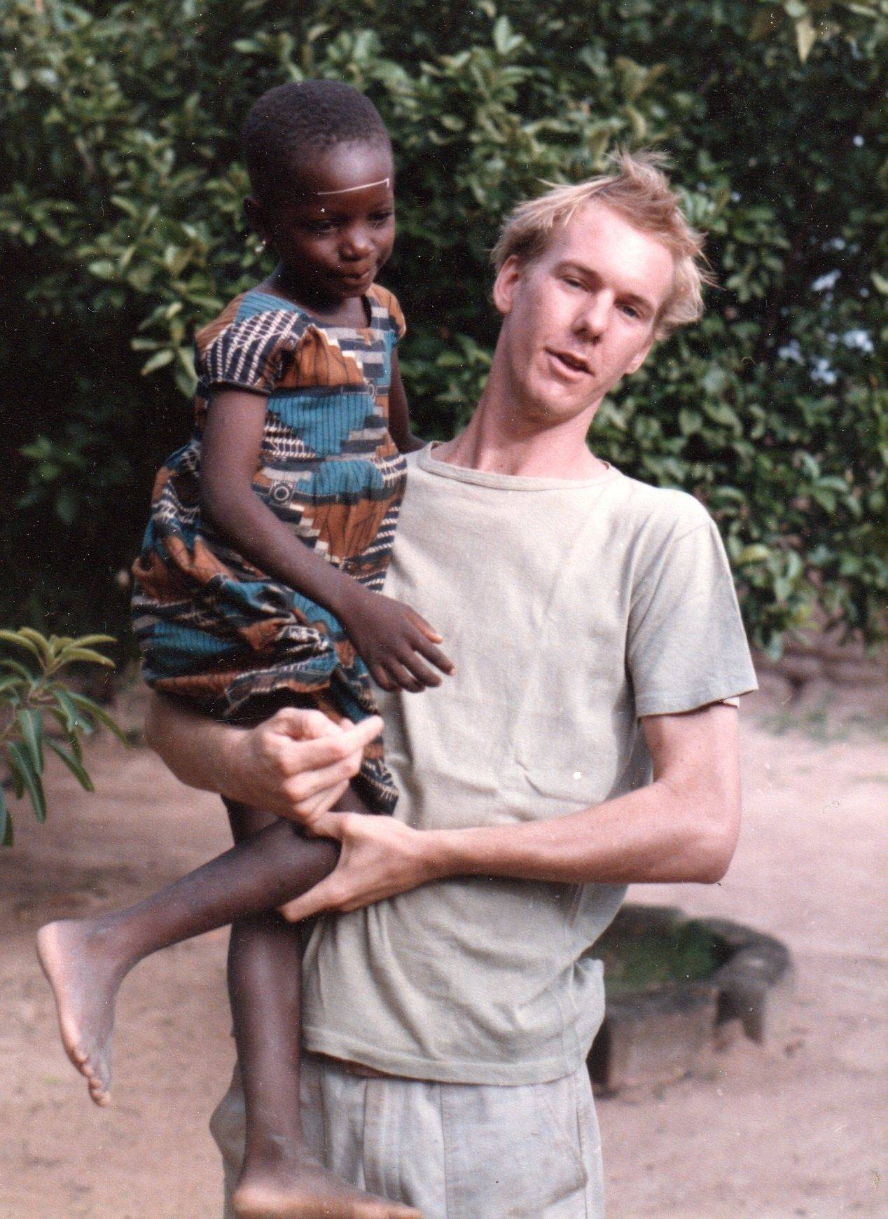 Rich Johnson, with one of his host family's kids in Western Africa.