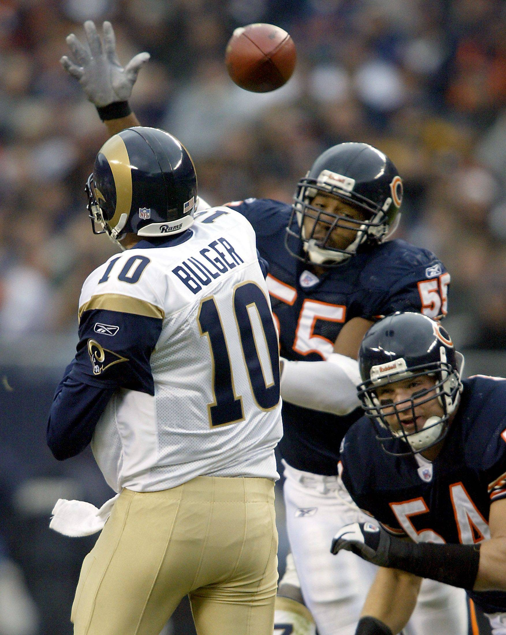 Bears Lance Briggs and Brian Urlacher put pressure on the Rams Marc Bulger as he releases the ball during the bears loss to the St Louis rams 23-21 Sunday at Soldier Field.