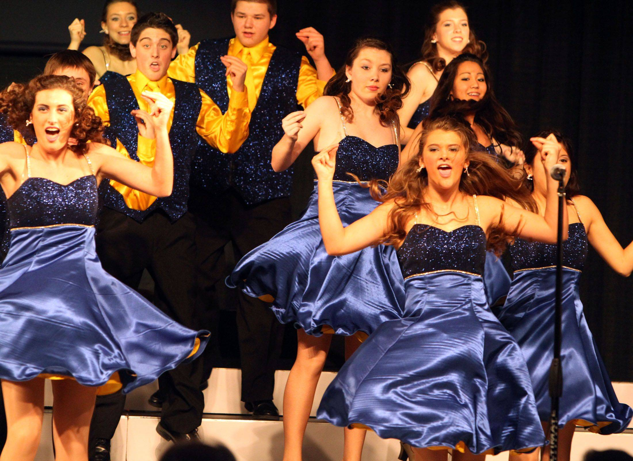 Wheaton North's Flight competes in the festival division at the 18th annual Chicagoland Showcase choir competition at Hersey in Arlington Heights on Saturday.