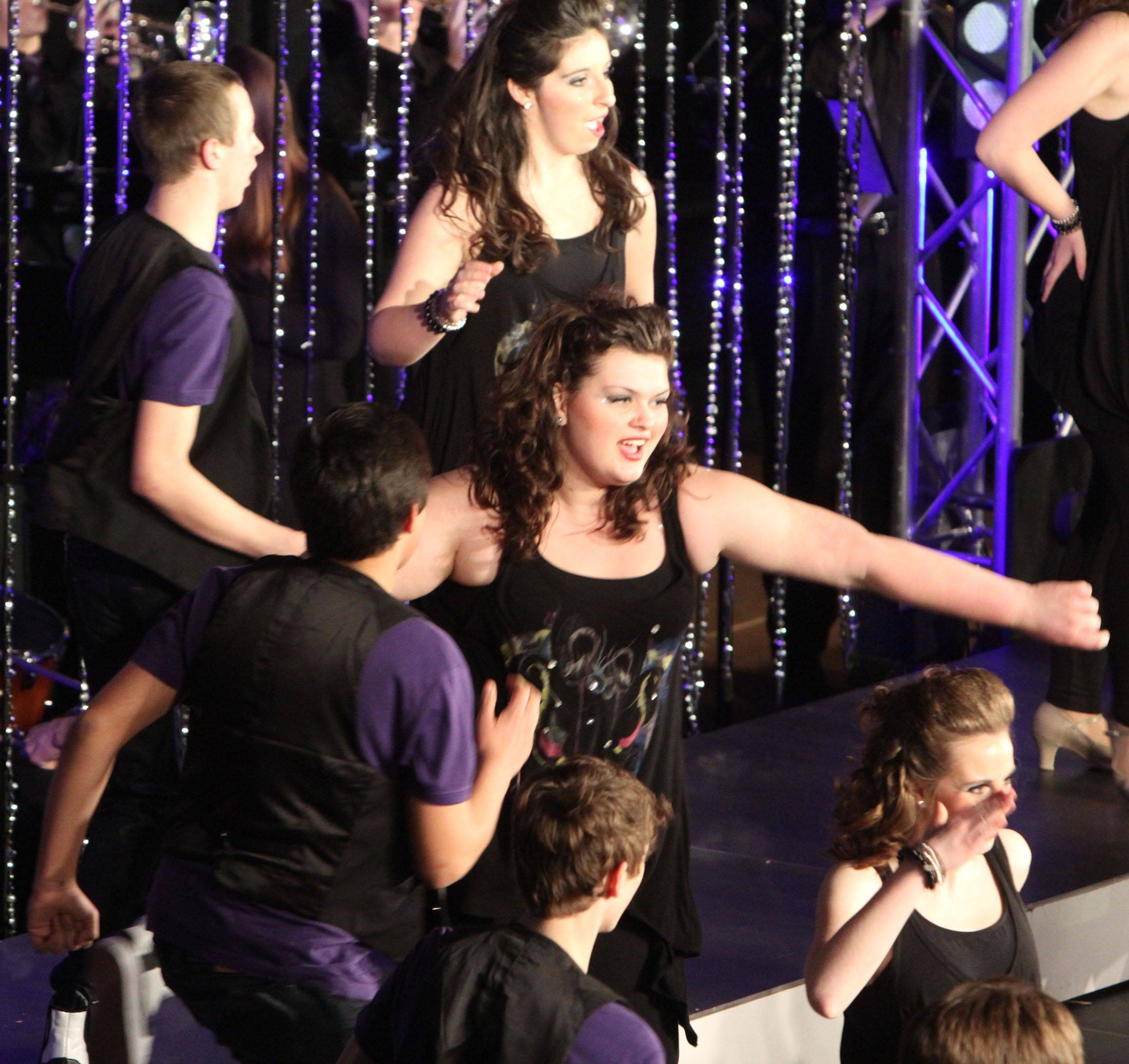 Prospect's Mixed Company competes in the 18th annual Chicagoland Showcase choir competition at Hersey in Arlington Heights on Saturday.