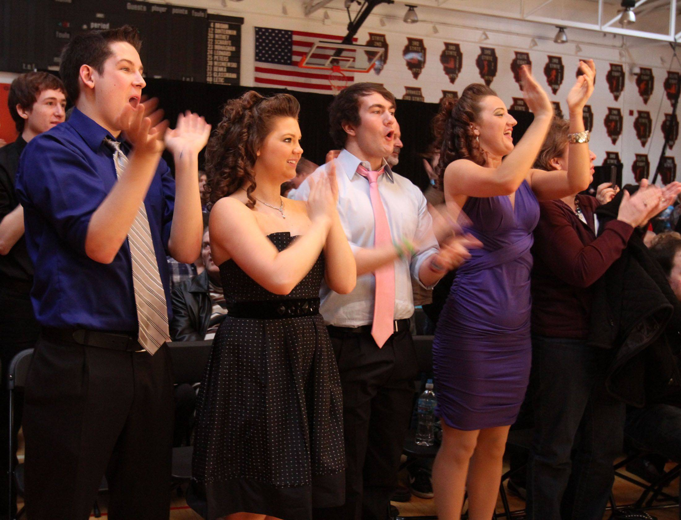 Fans cheer to Buffalo Grove's New Vibes competing in the festival division at the 18th annual Chicagoland Showcase choir competition at Hersey in Arlington Heights on Saturday.