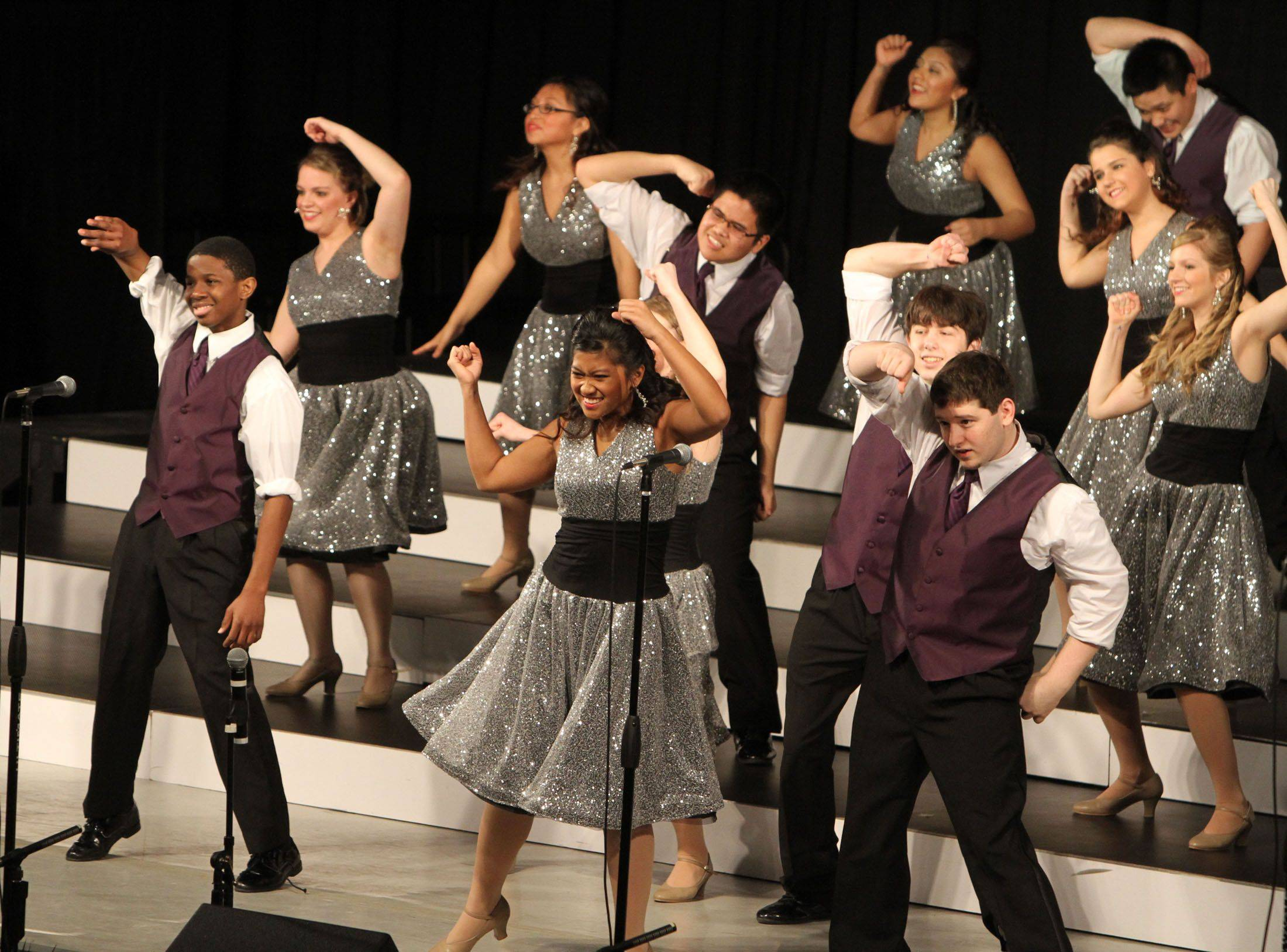 Wheeling's New Dawn competes in the festival division at the 18th annual Chicagoland Showcase choir competition at Hersey in Arlington Heights on Saturday.
