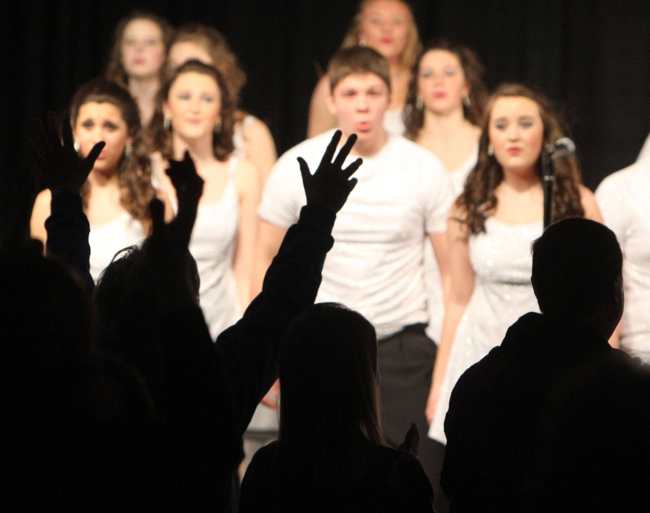 Wheaton North's Flight gets a big hand after competing in the festival division at the 18th annual Chicagoland Showcase choir competition at Hersey in Arlington Heights on Saturday.