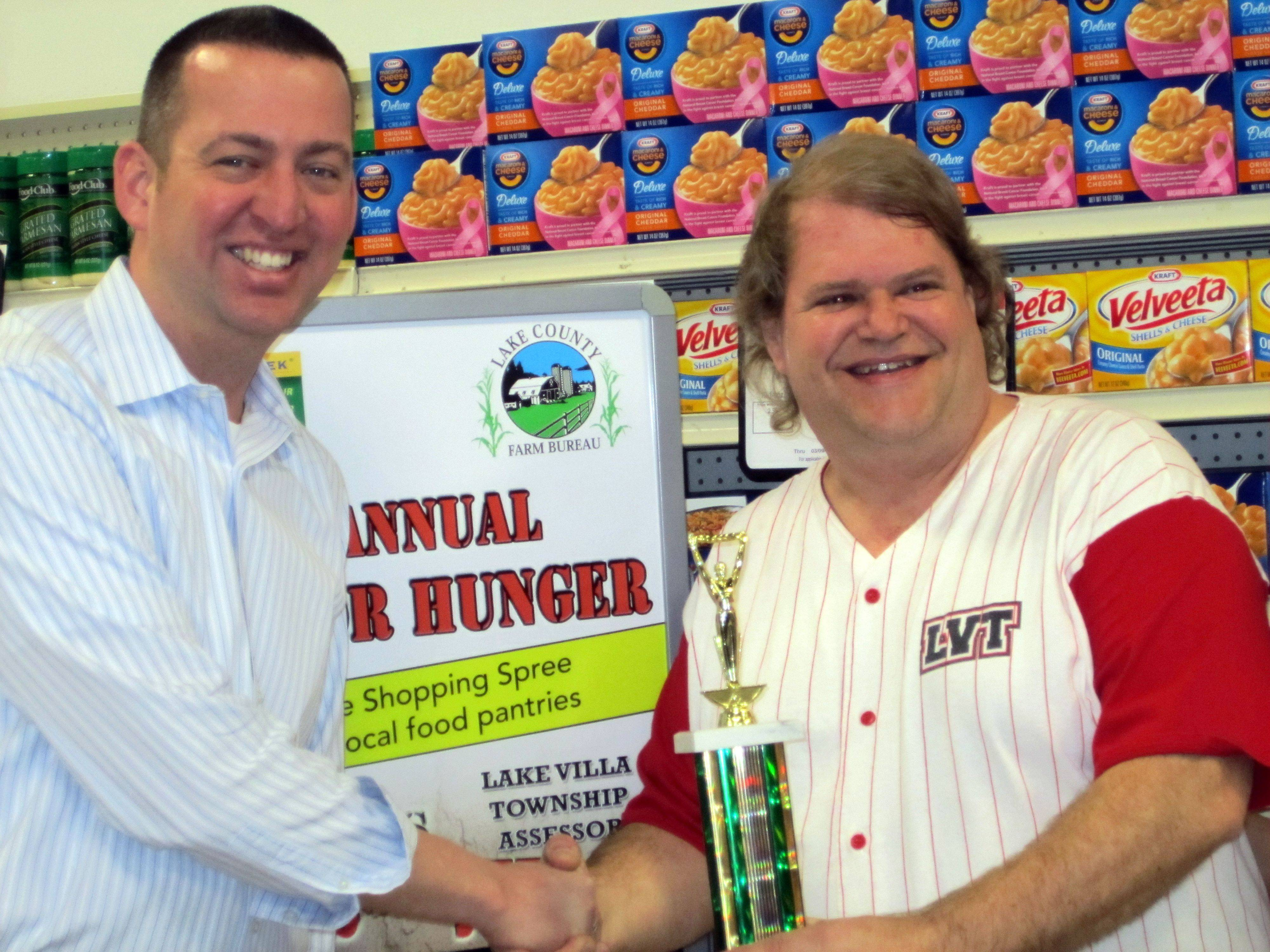 Lake County Farm Bureau Manager Greg Koeppen, left, congratulates Lake Villa Township Assessor Jeff Lee, the winner of this year's Race for Hunger event.