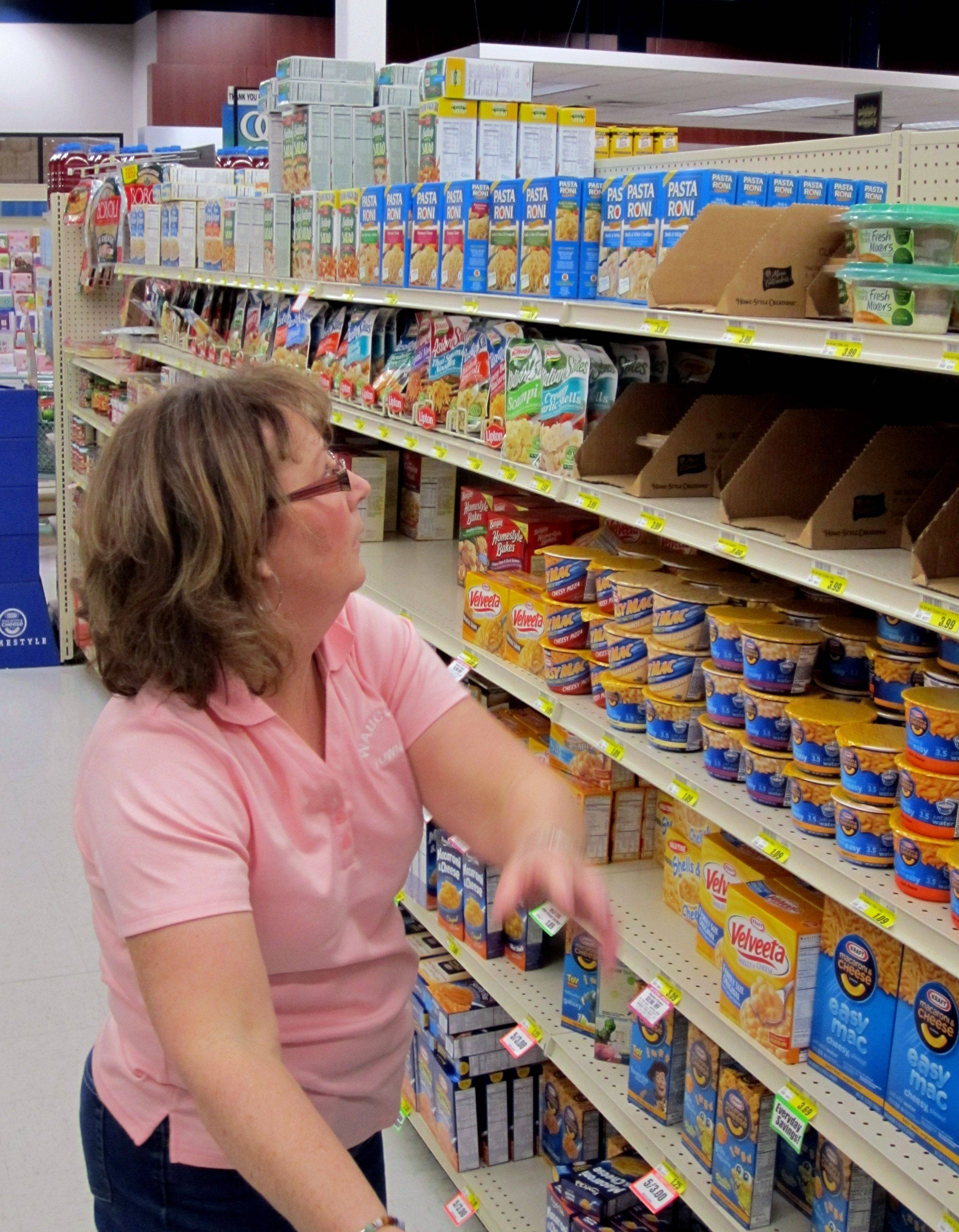 Wauconda Township Assessor Patricia Oaks reaches for more non-perishables during the Lake County Farm Bureau's Race for Hunger event Thursday at the Zion Piggly Wiggly store.