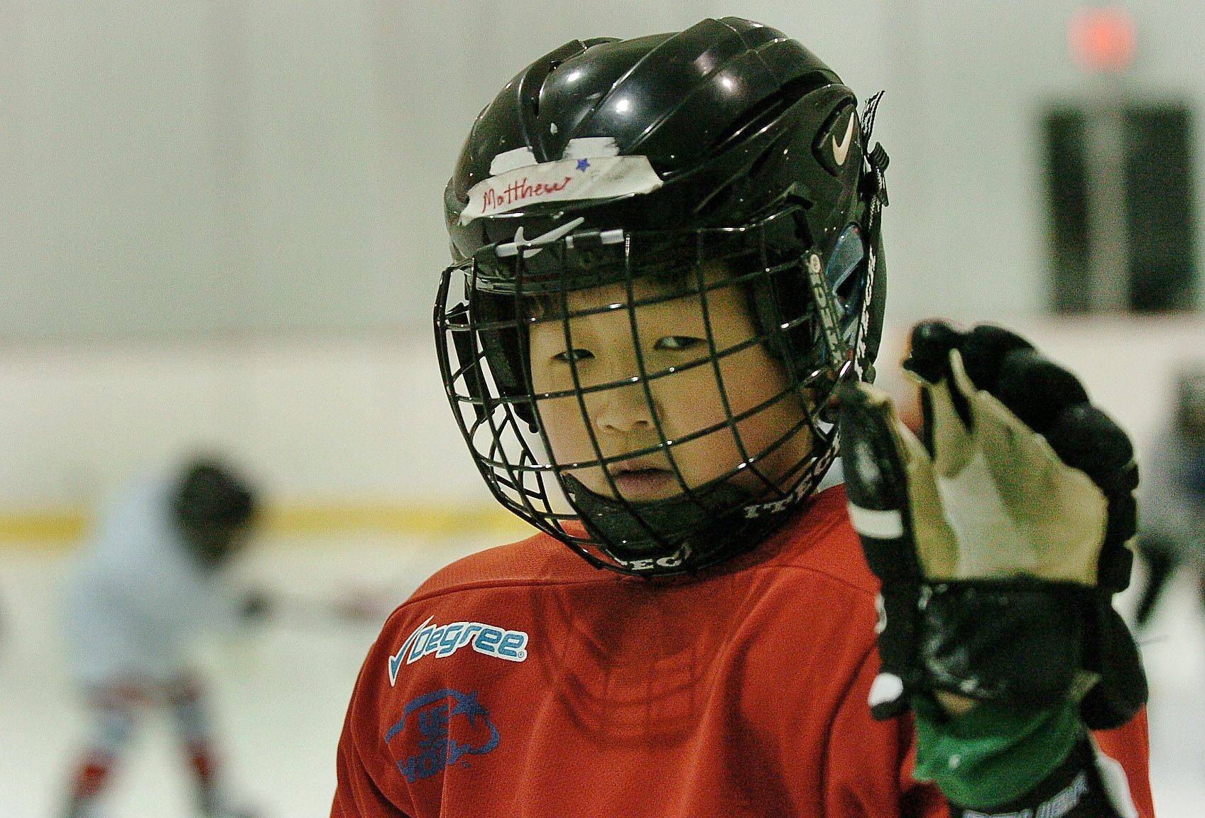 Matthew Bae, 11, of Algonquin waits for the open skate before practice for the Hoffman Estates Park District's youth ice hockey program.