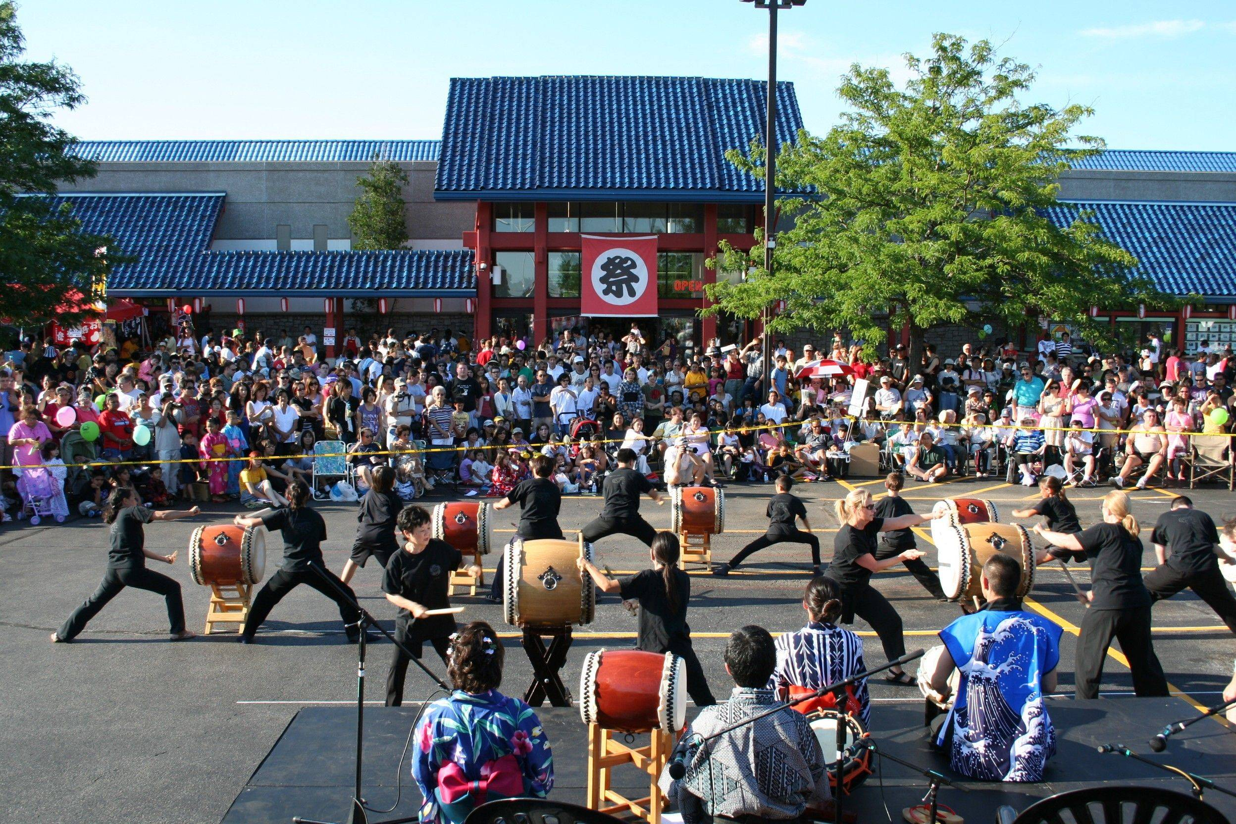 Traditional Japanese Taiko drummers make music at the Bon-Dancing festival at Mitsuwa Marketplace in Arlington Heights.