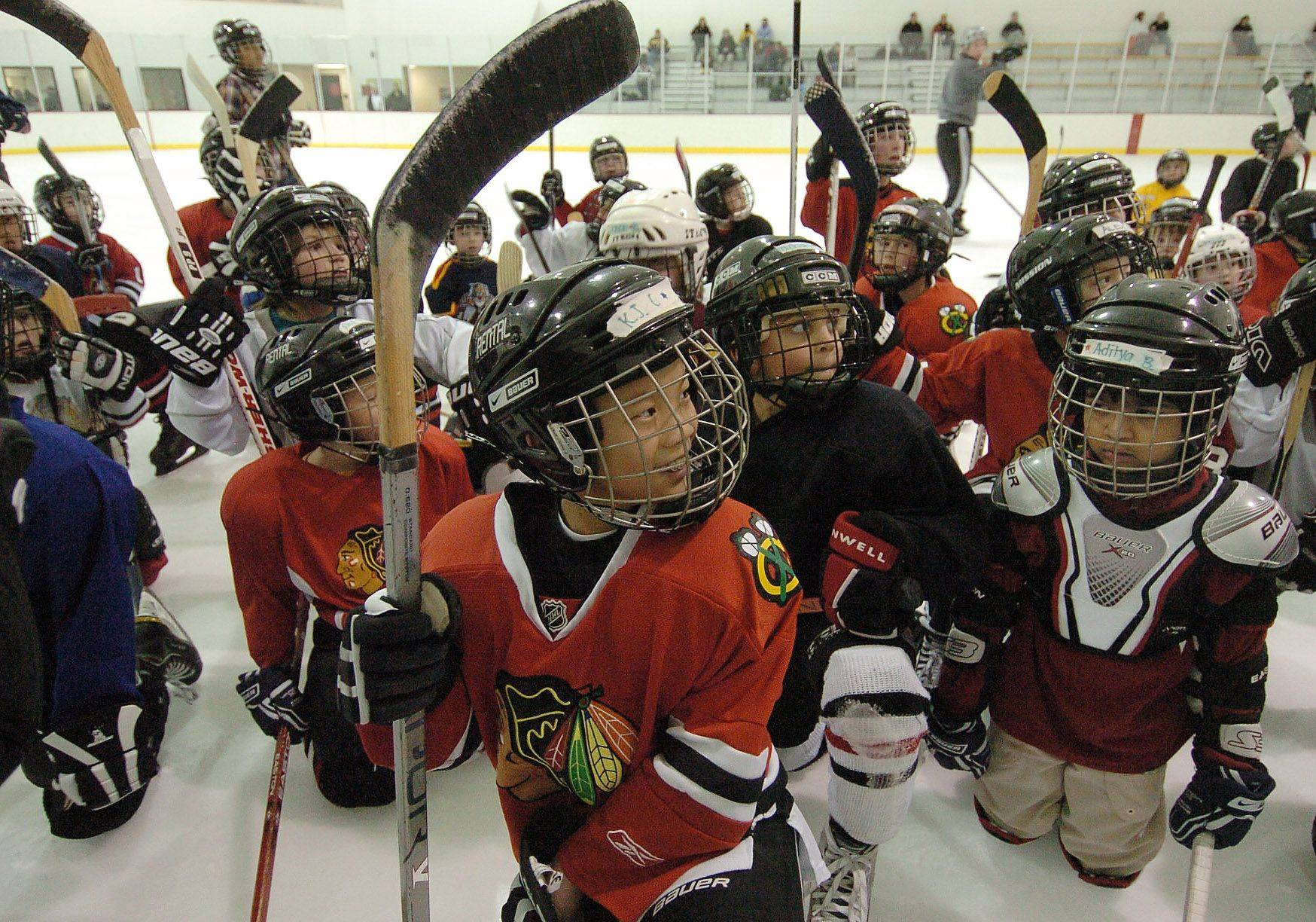 The increased diversity of the Hoffman Estates Park District's youth ice hockey programs reflects 2010 census data showing a surging suburban Asian population. Hockey, a sport that traditionally struggles with drawing minorities, now draws players like 10-year-old K.J. Choy of Hoffman Estates and his teammates, who listen to their coach during practice at the Triphahn Center.