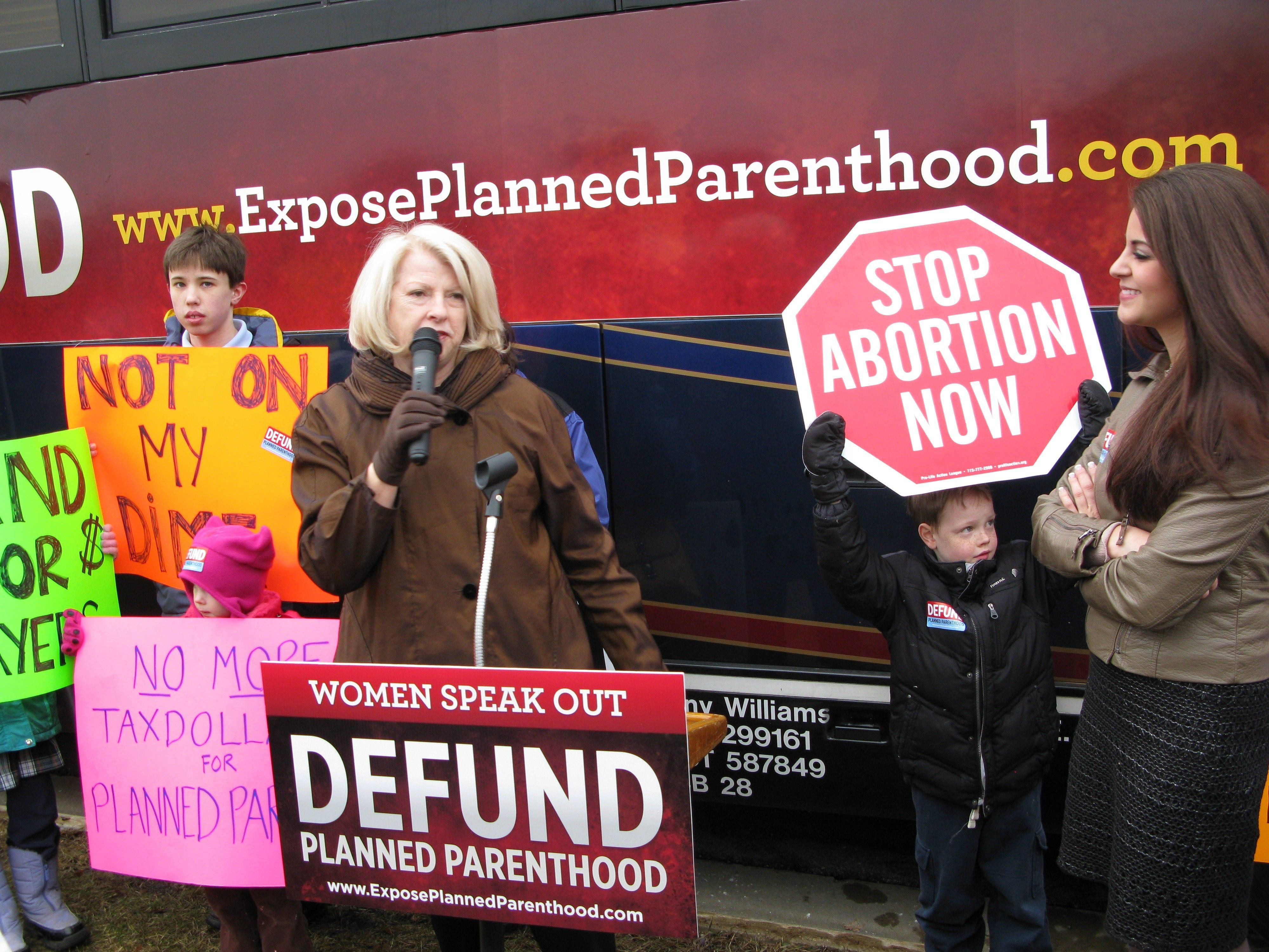 Former Colorado Congresswoman Marilyn Musgrave, left, led a group of abotrion opponents in speaking Monday outside Congressman Randy Hultgren's Geneva office. Among other things, Musgrave said Planned Parenthood engages in aiding and abetting sex trafficking.