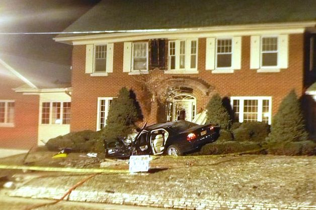 A vehicle sits in front of the house on River Bluff Road in Elgin where it crashed early Sunday morning.