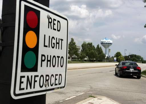 A majority of the candidates running for three seats on the Libertyville village board say red-light cameras are doing the job and should stay in place.