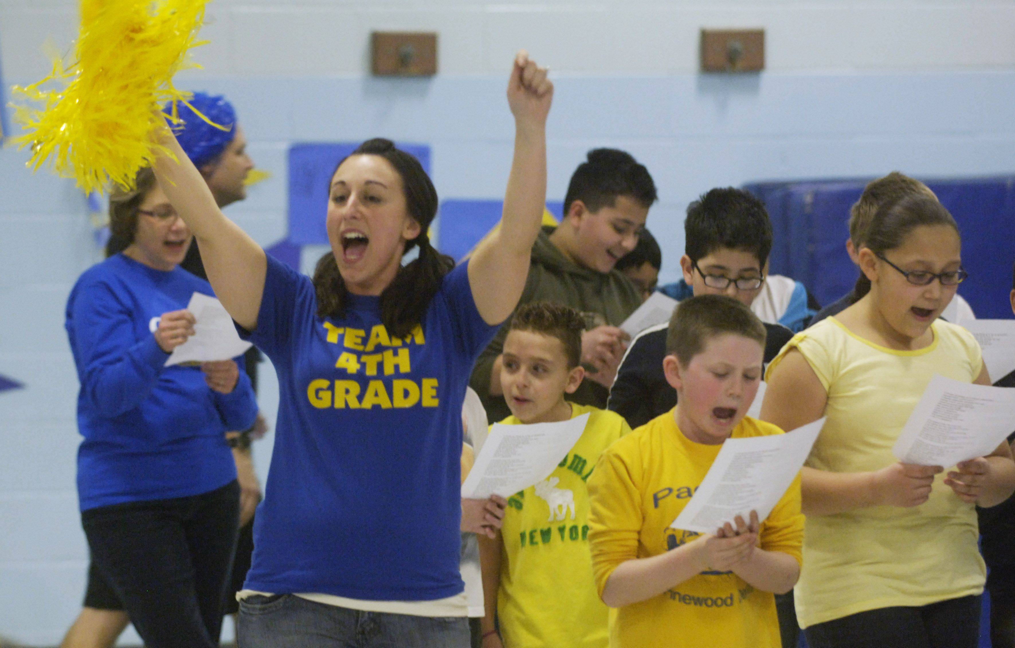 Fourth-grade teacher Stephanie Keadle cheers students on during a pep rally for next week's ISAT test at Orchard Place school in Des Plaines.