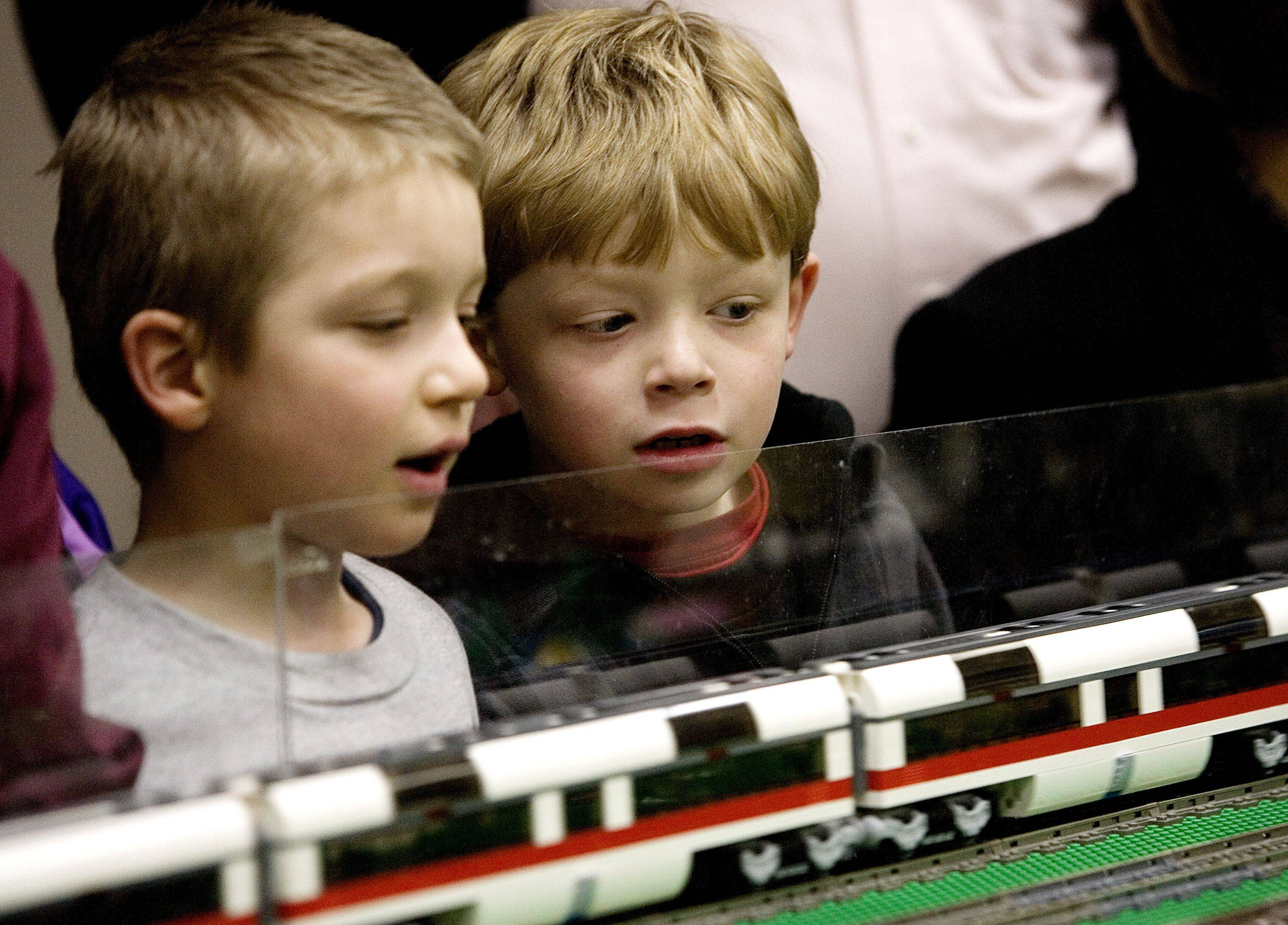 Drew Iversen,6, and Vince Vassolo,6, of Lombard check out The Northern Illinois Lego Train club's display at The Helen Plum Libraly Sunday in Lombard.