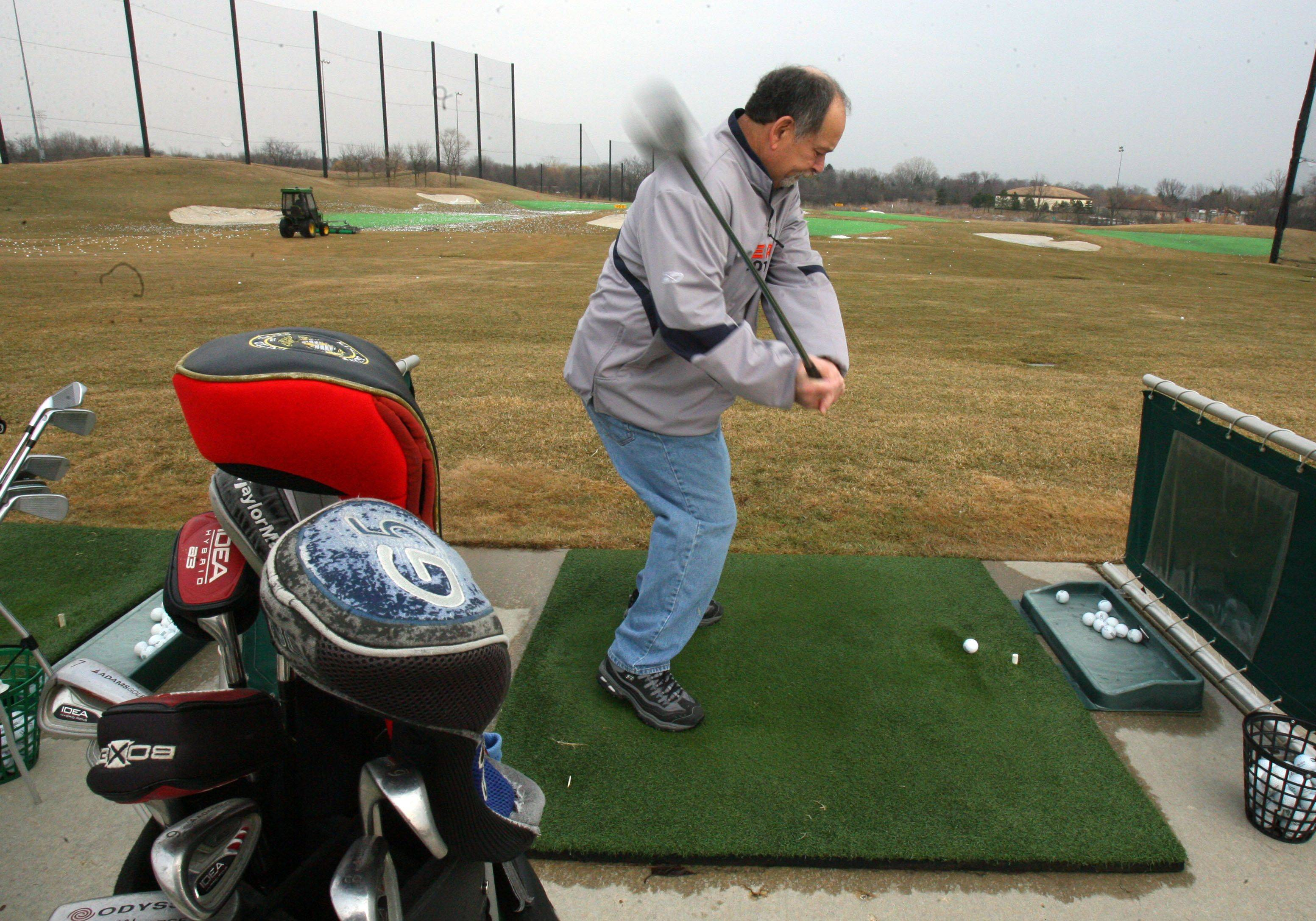 Curt Corsi of Gurnee takes advantage of temperatures in the 40's to hit some balls at the Libertville Sports Complex Friday afternoon.