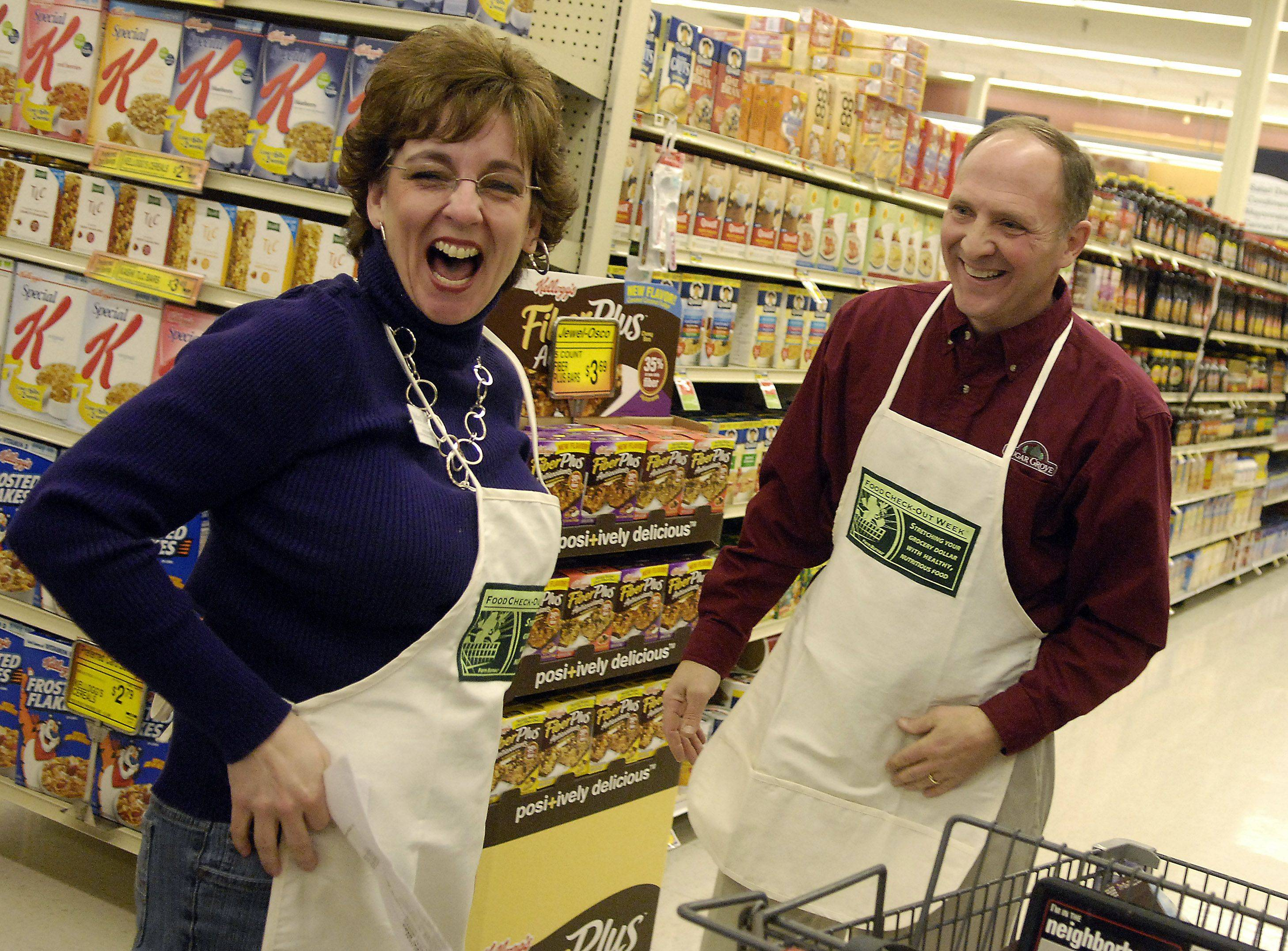 Mayor Sean Michels of Sugar Grove and his partner Melisa Taylor share a laugh after their 5 minute shopping spree ends during Friday's 10th-annual Farm Bureau Food Check-Out Challenge at Jewel in Batavia Friday.