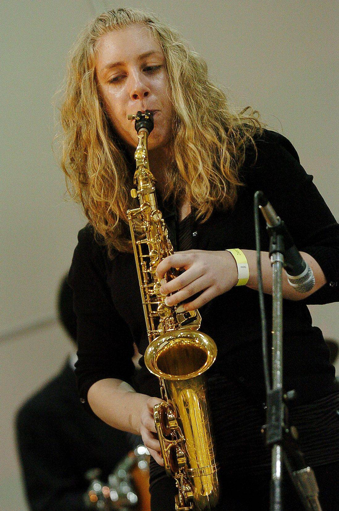Saxophonist Emily Gasteyer plays with the Naperville North Jazz Ensemble during the 26th-annual Jazz in the Meadows High School jazz band concert at Rolling Meadows High School.