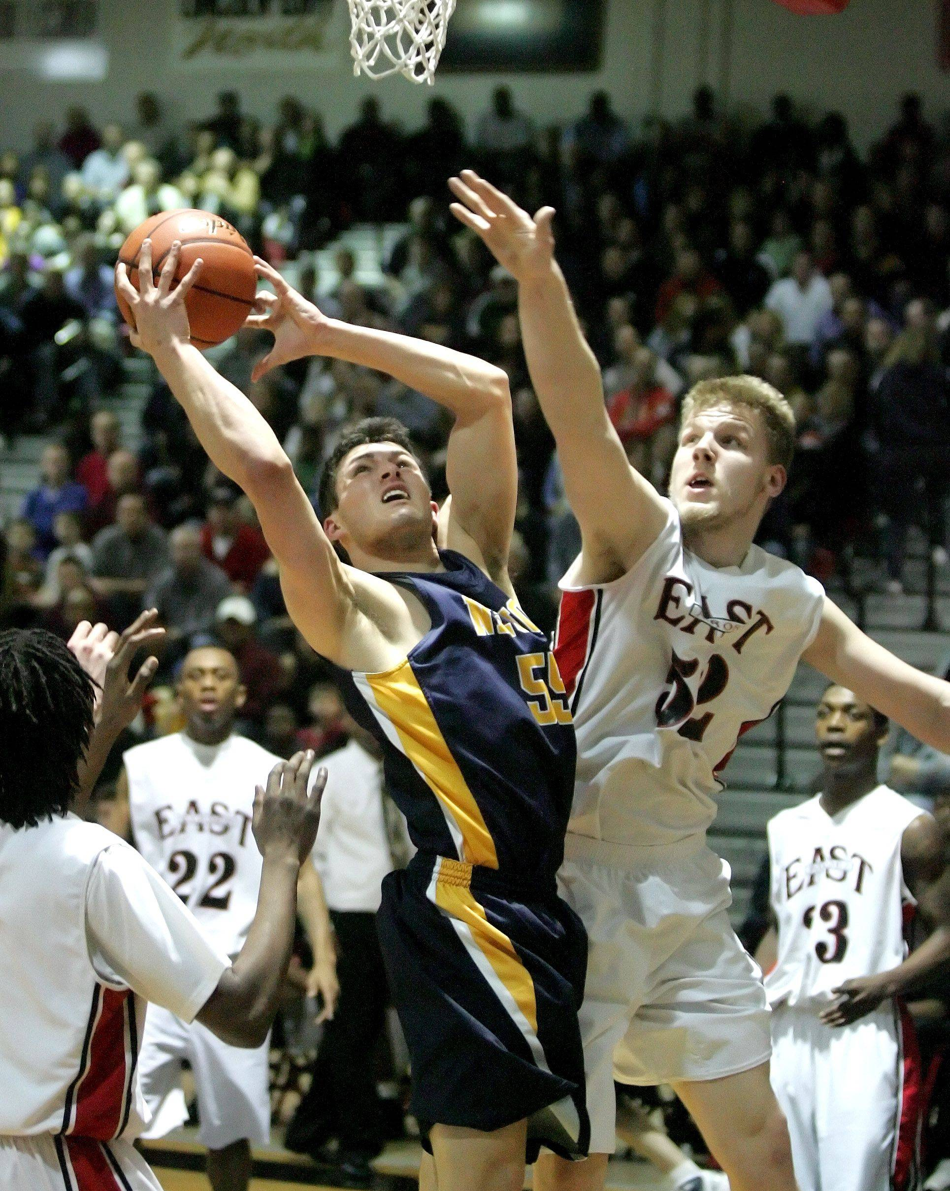 Neuqua Valley's Alex Karkazis, left, takes a shot past East Aurora's Tom Okapal during Friday's regional basketball final at Bolingbrook High School.