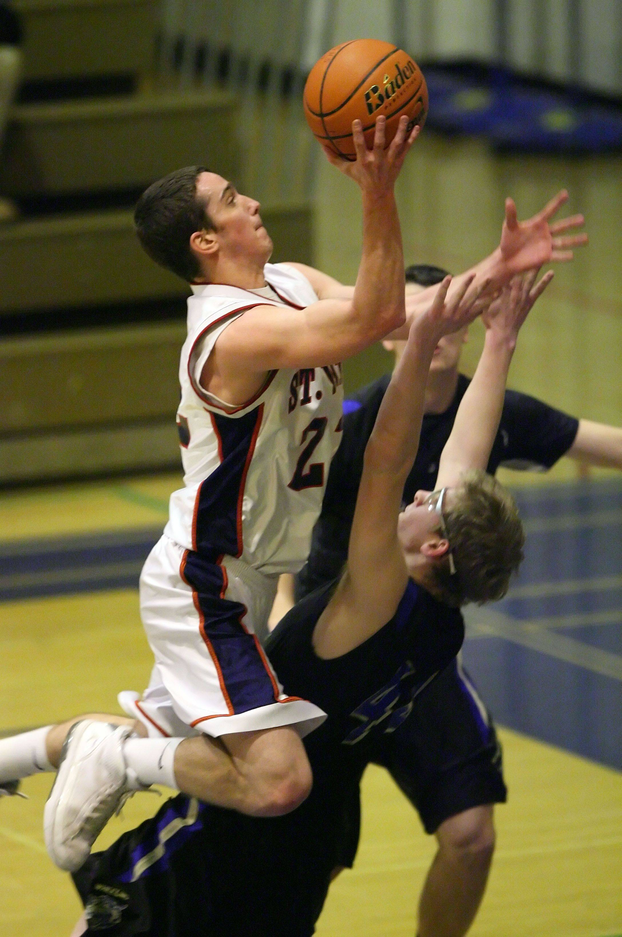 St. Viator's Quinn Murray drives on Wheeling's Matt Hart during their regional game Monday night at Wheeling High School.