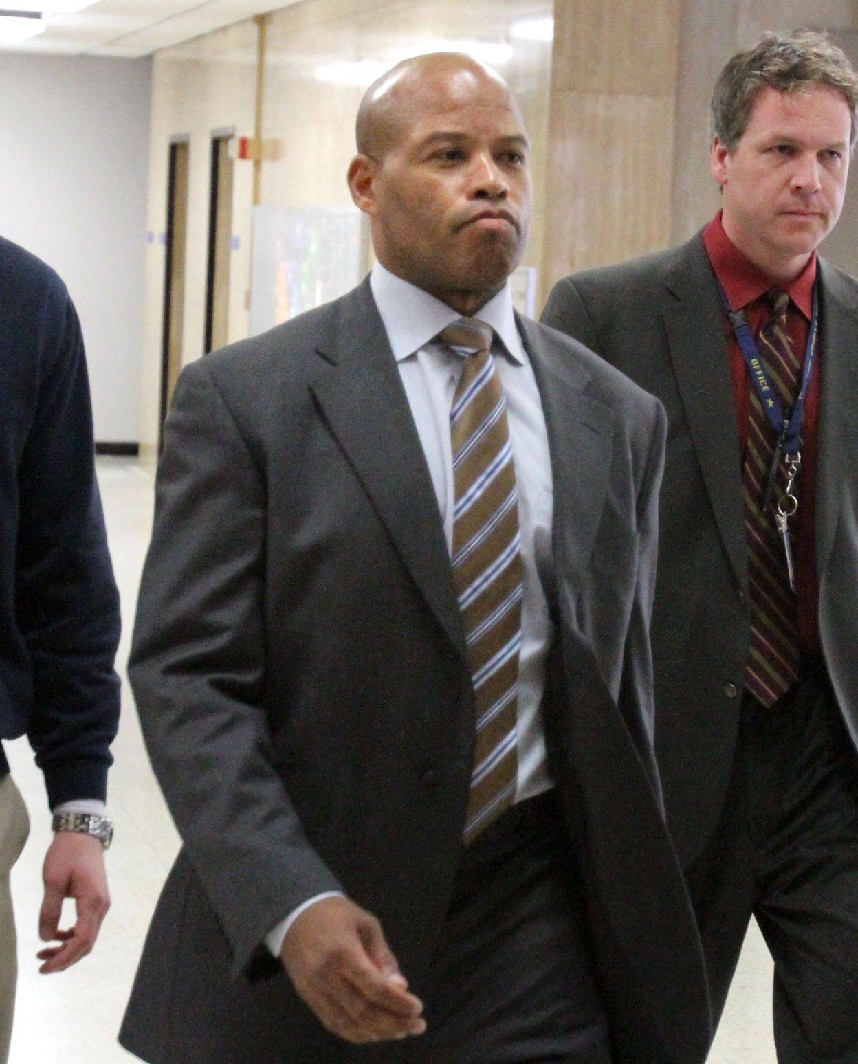 Former Chicago Bears player Shaun Gayle arrives at the Lake County Courthouse to testify in the Marni Yang trial on Tuesday in Waukegan.