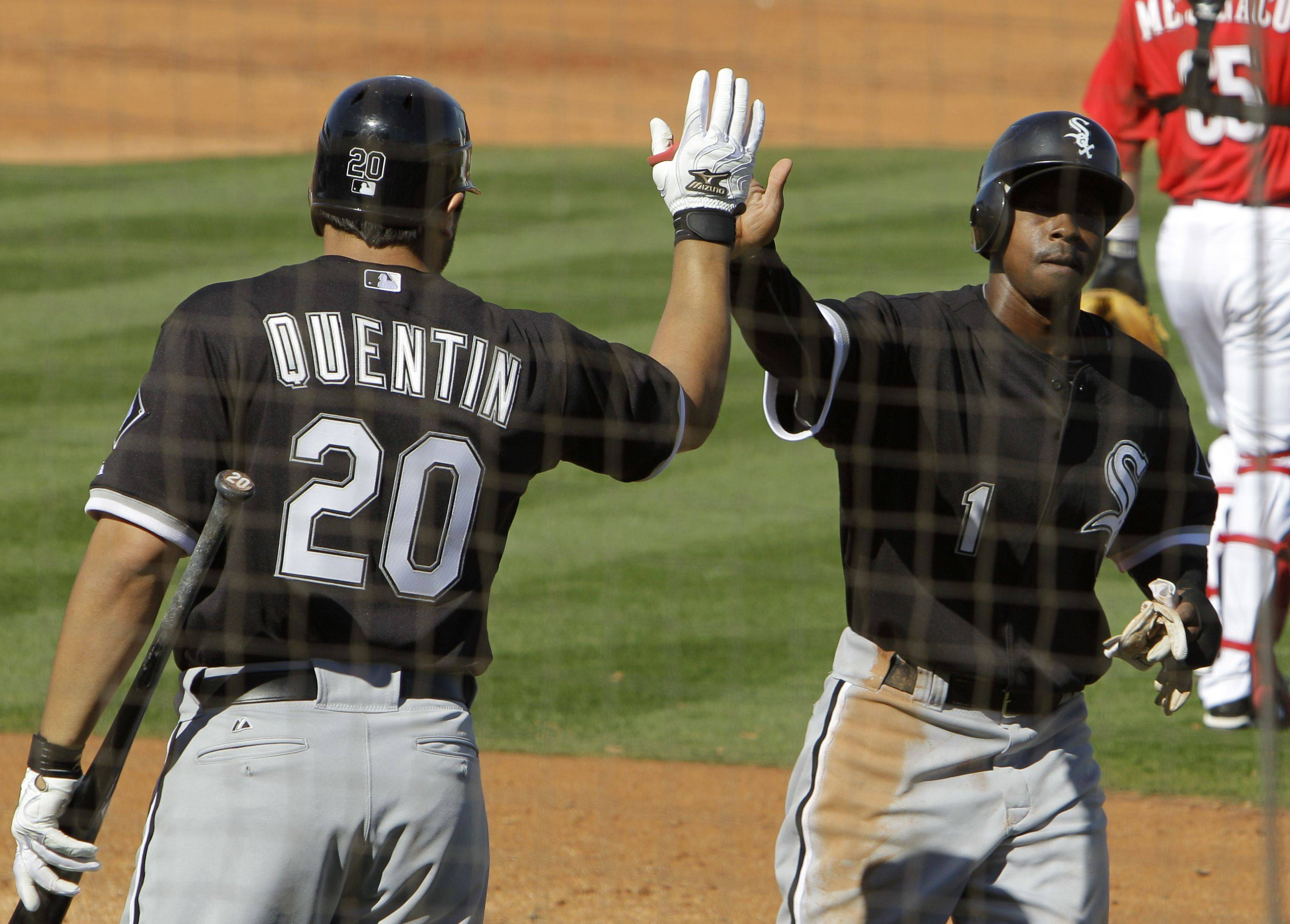 Juan Pierre is greeted by Carlos Quentin after scoring on a single by Paul Konerko in a Cactus League game last week in Glendale, Ariz.