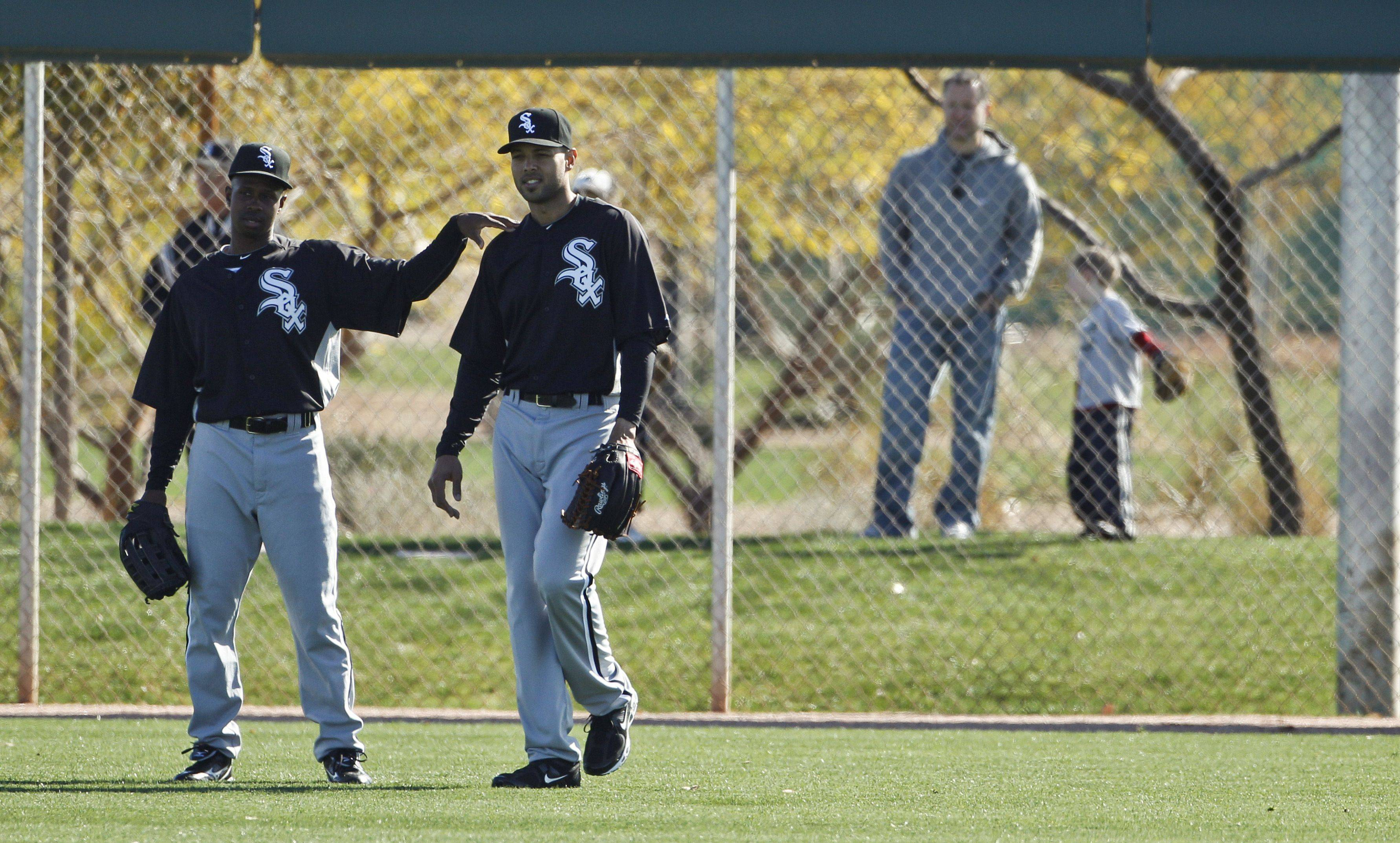 White Sox manager Ozzie Guillen says no one works harder in baseball than outfielder Juan Pierre, left, who talks with Alex Rios during workouts last month in Glendale, Ariz.