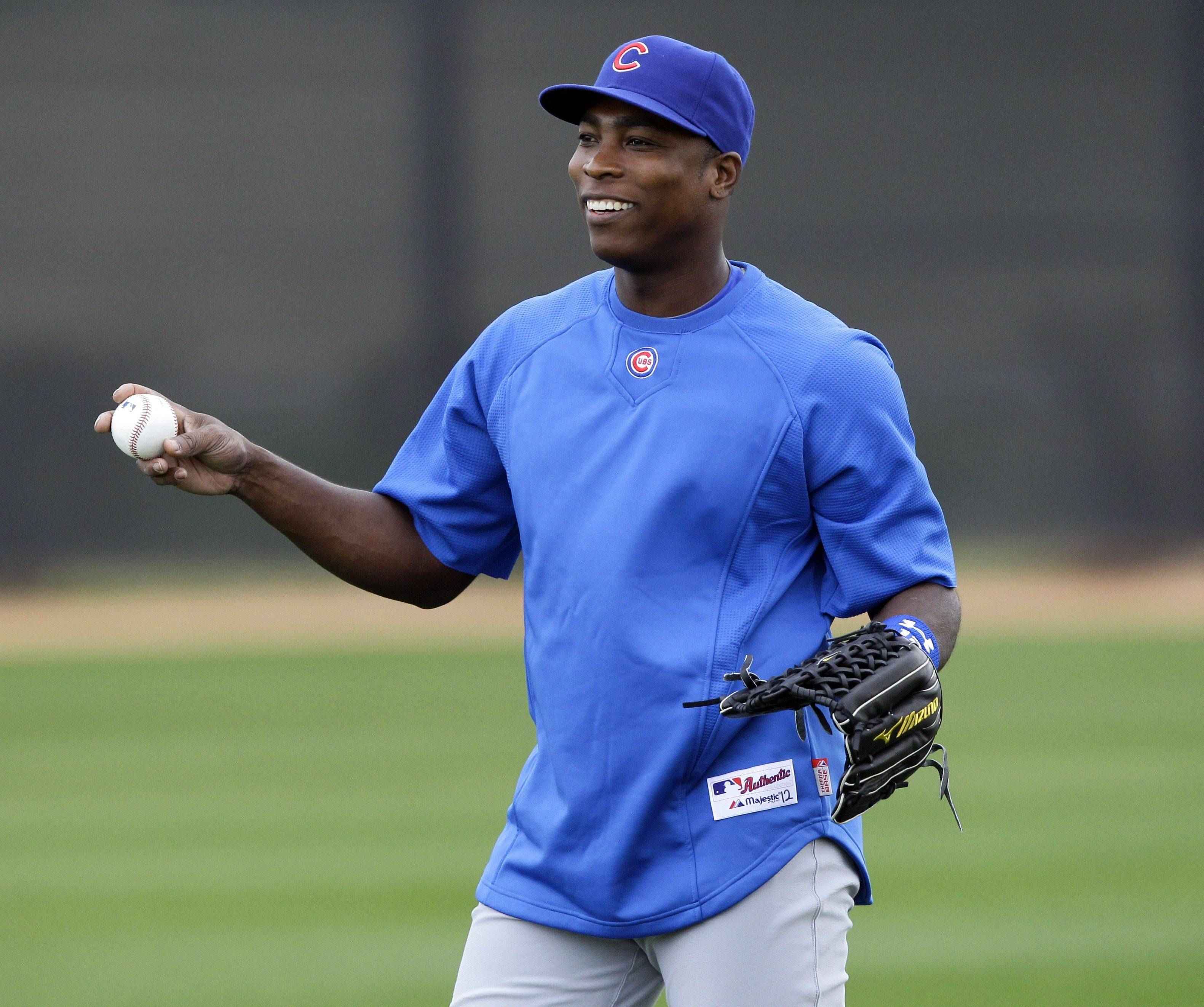 Outfielder Alfonso Soriano, here warming up at spring training camp in Mesa, Ariz., is halfway through his eight-year, $136 million contract with the Cubs.