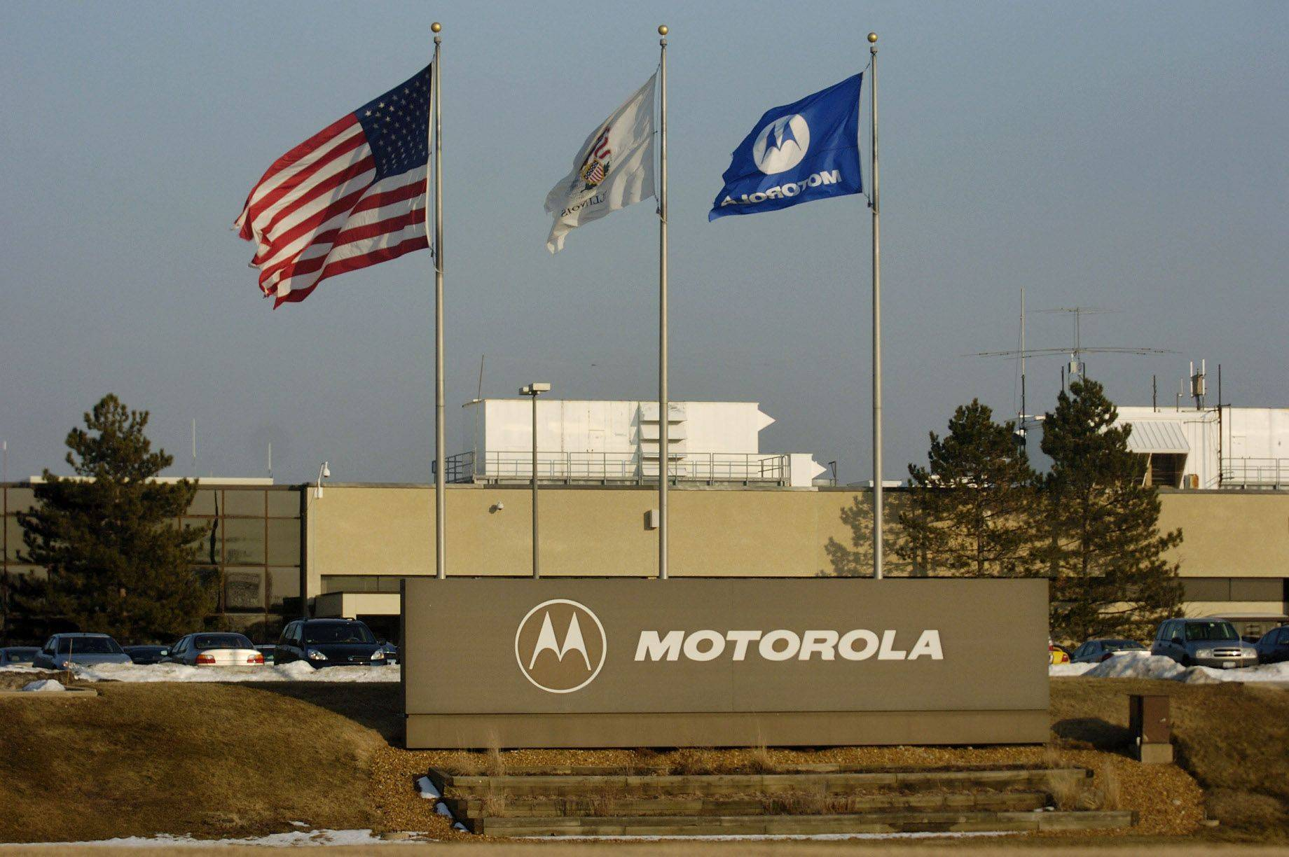 Motorola Solutions' Arlington Heights campus remains in limbo as the Chinese government Wednesday delayed a sale of the company's networks business to Nokia Siemens.