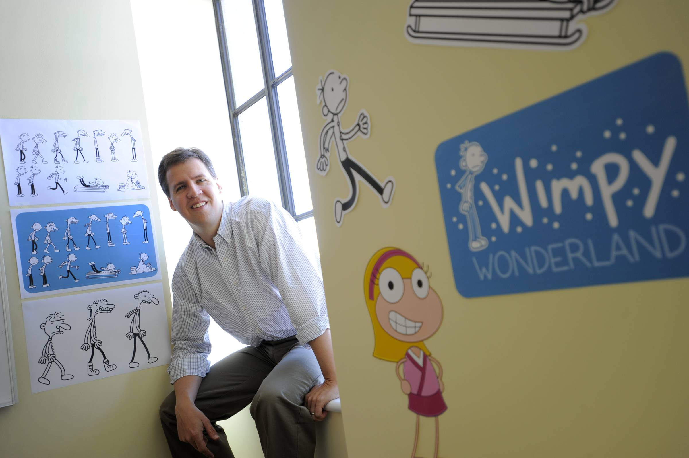 "Jeff Kinney, author of the children's book series, ""Diary of a Wimpy Kid,"" poses for a portrait at his office in Boston."