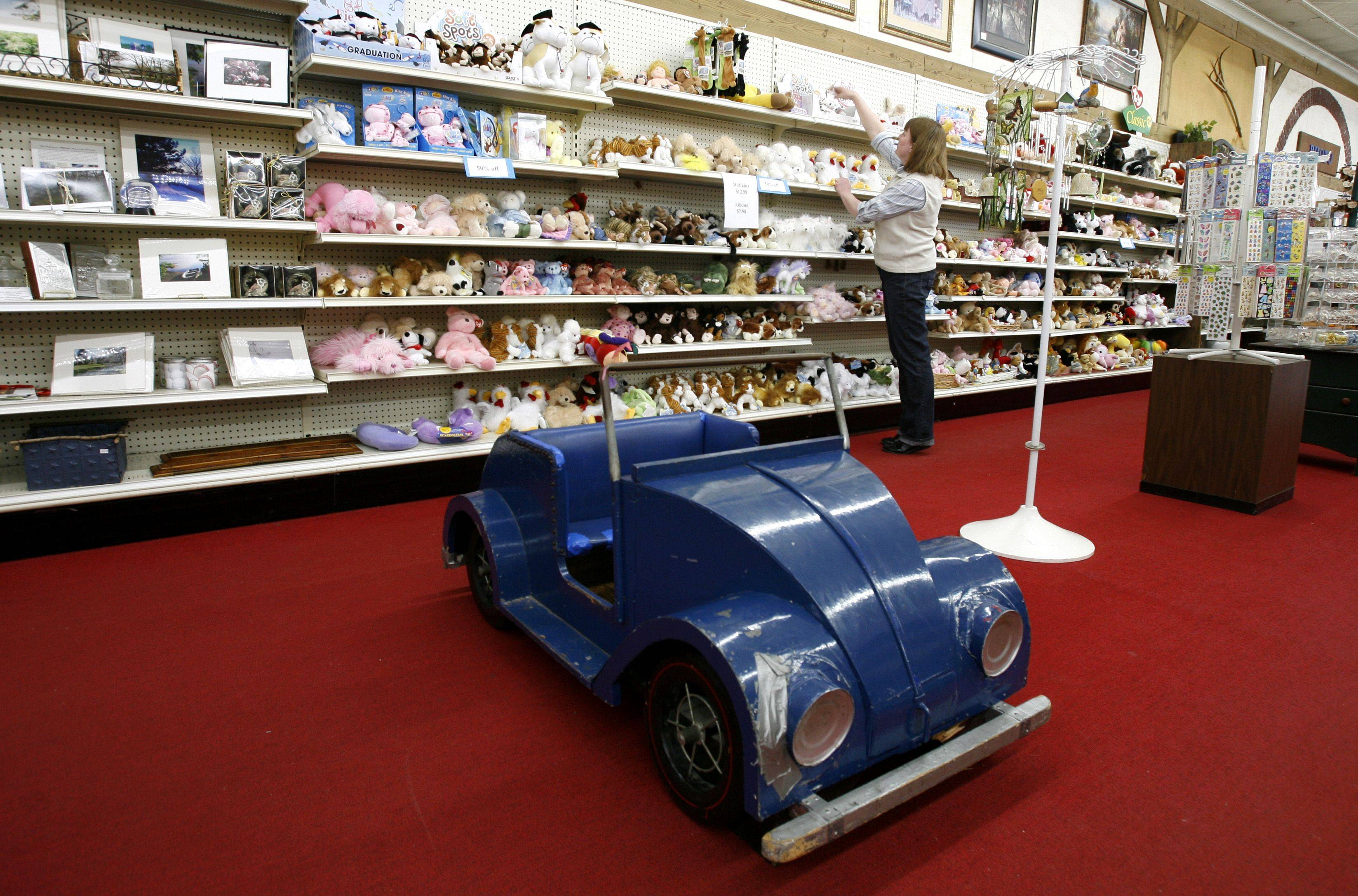 Schmid's, a downtown Glen Ellyn business for 44 years, will be closing its doors March 19. Children often would sit in the store's miniature Volkswagen Beetle, which is modeled off its old delivery car.