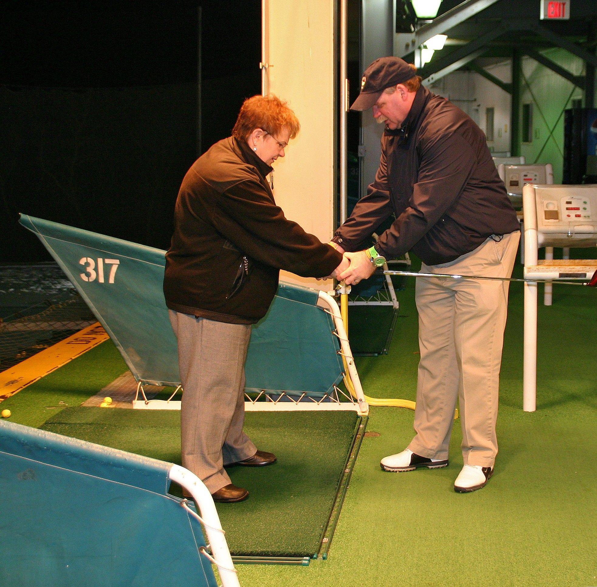 Des Plaines City Clerk Gloria Ludwig gets some grip tips from GolfTEC pro Tom Portera at the Feb. 24 Ladies Night at Golf Center Des Plaines.