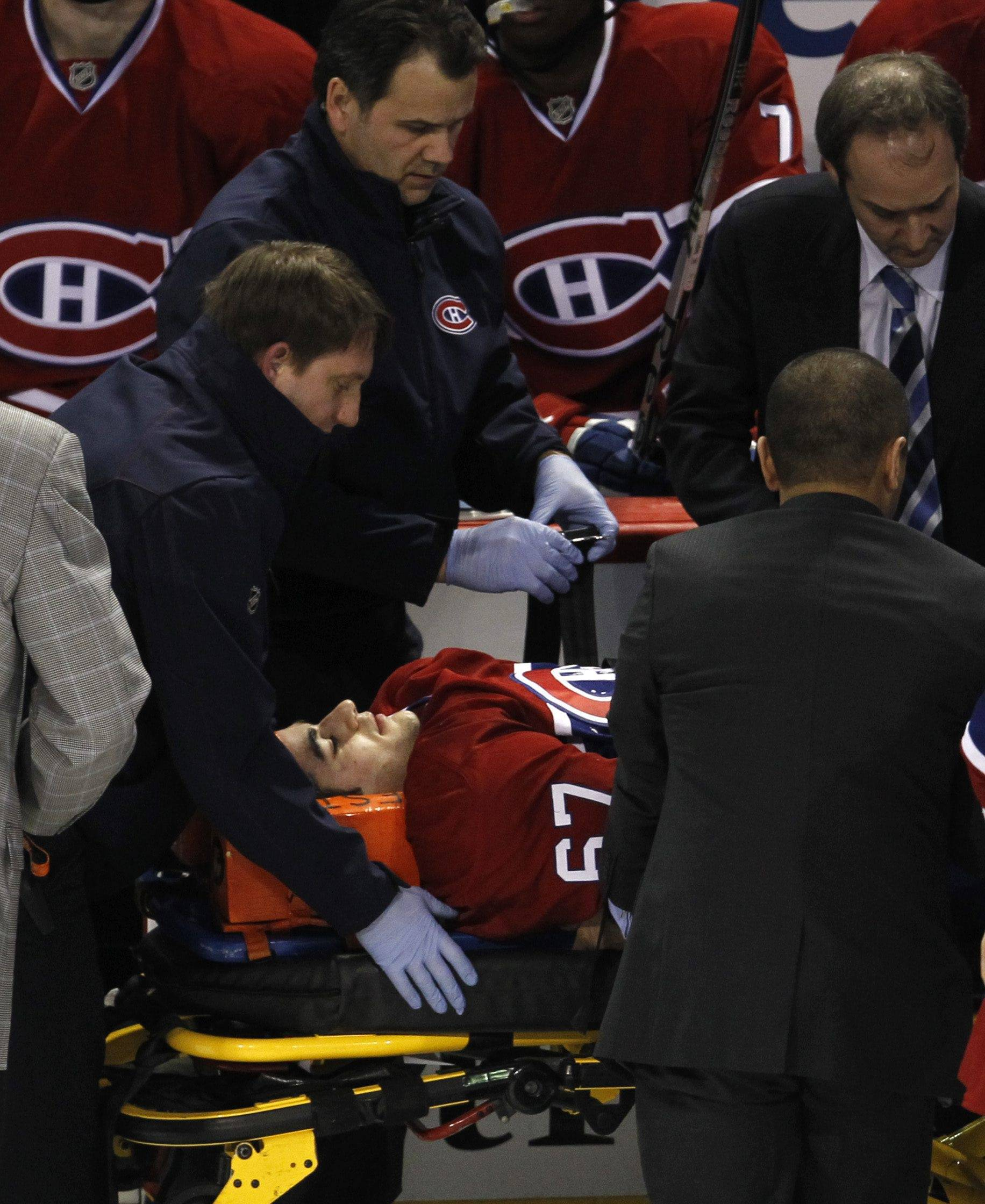 Montreal Canadiens' Max Pacioretty is wheeled away on a stretcher after taking a hit by Boston Bruins' Zdeno Chara.
