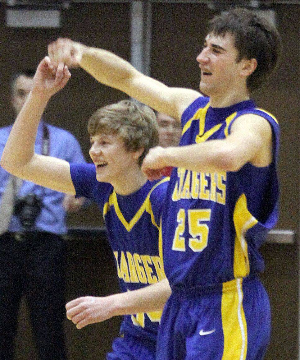 Aurora Central Catholic's Ryan Harreld, left, and Joey Mceachern celebrate a victory over Marian Central during sectional play at Woodstock North High School on Wednesday evening.
