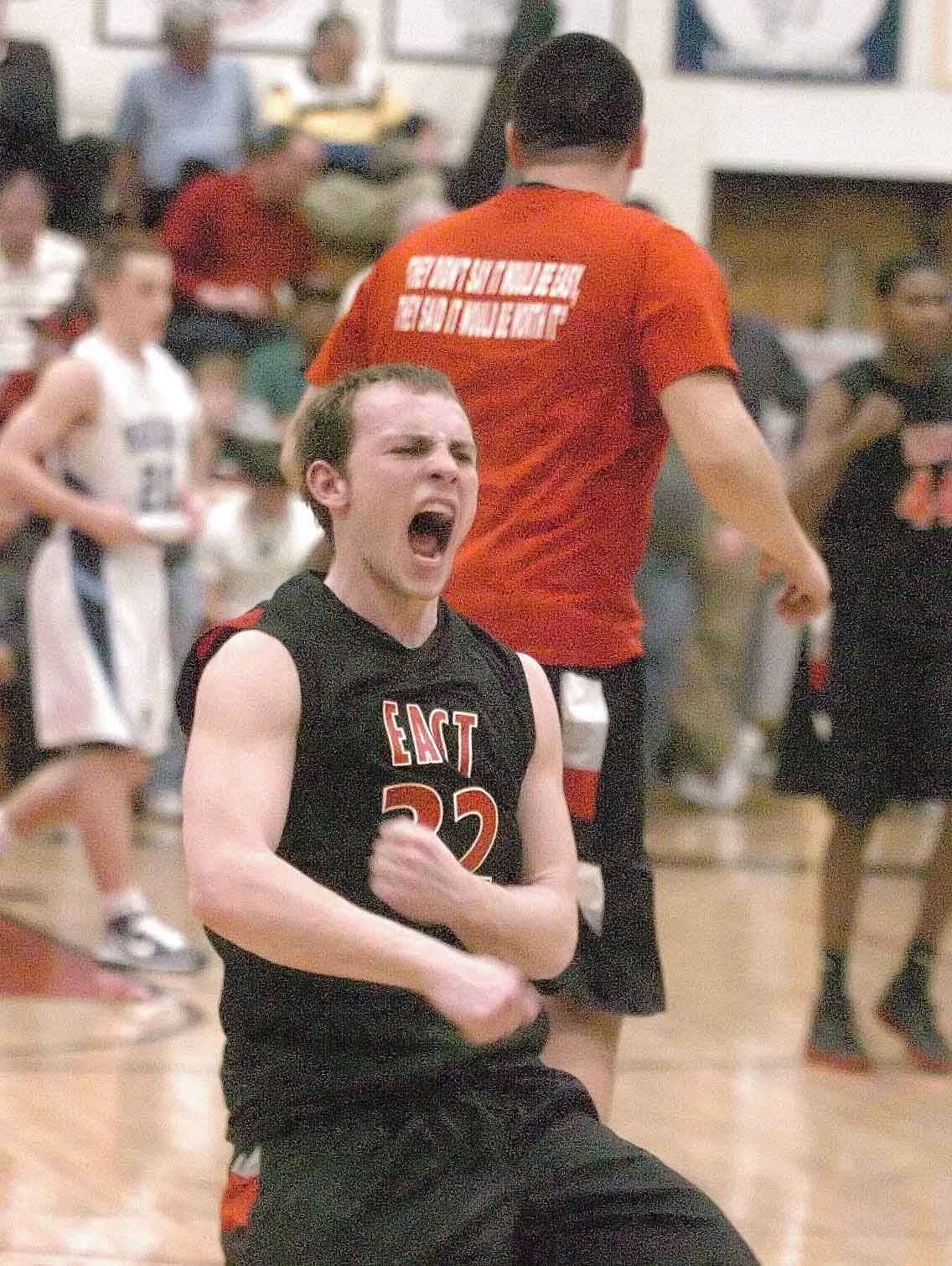 Zach Miller of Glenbard East lets out a scream after their big win. This took place during the Glenbard East vs. Downers Grove South at East Aurora game Wednesday.