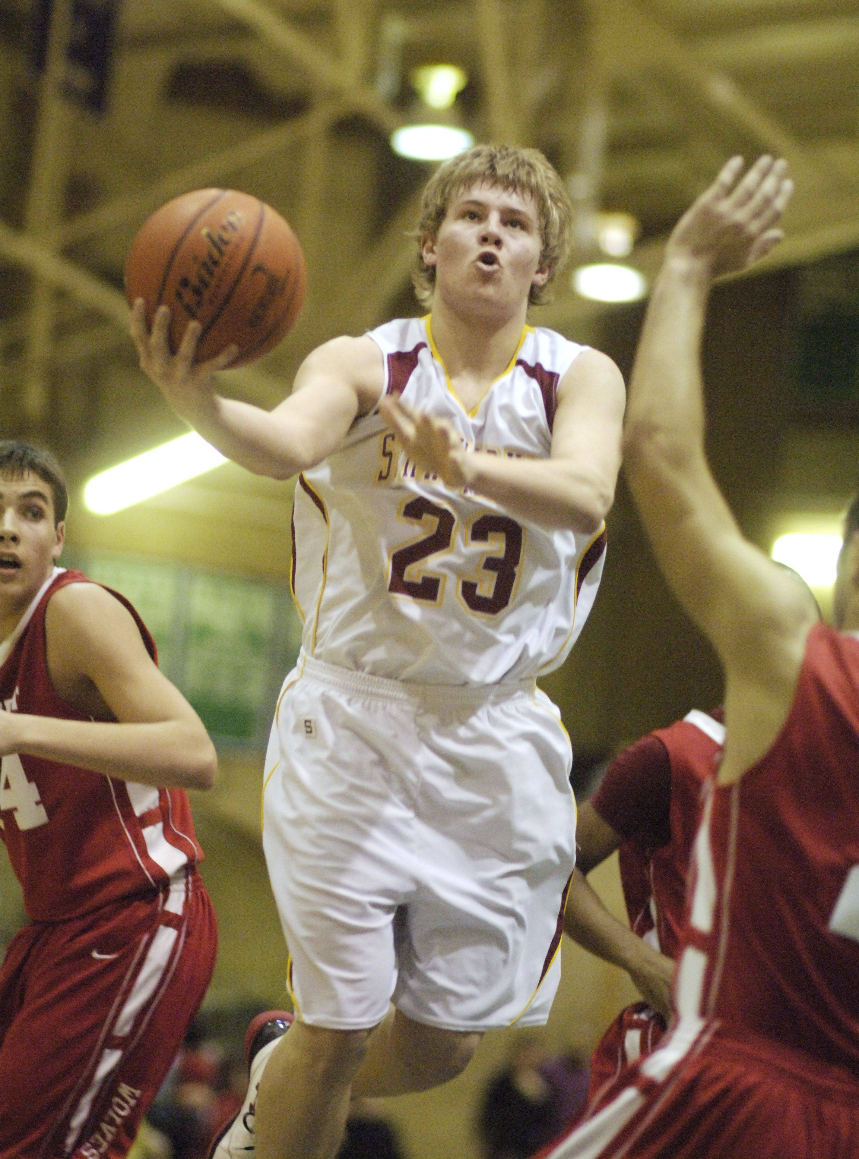 Schaumburg's Kyle Bolger drives to the basket against Niles West.