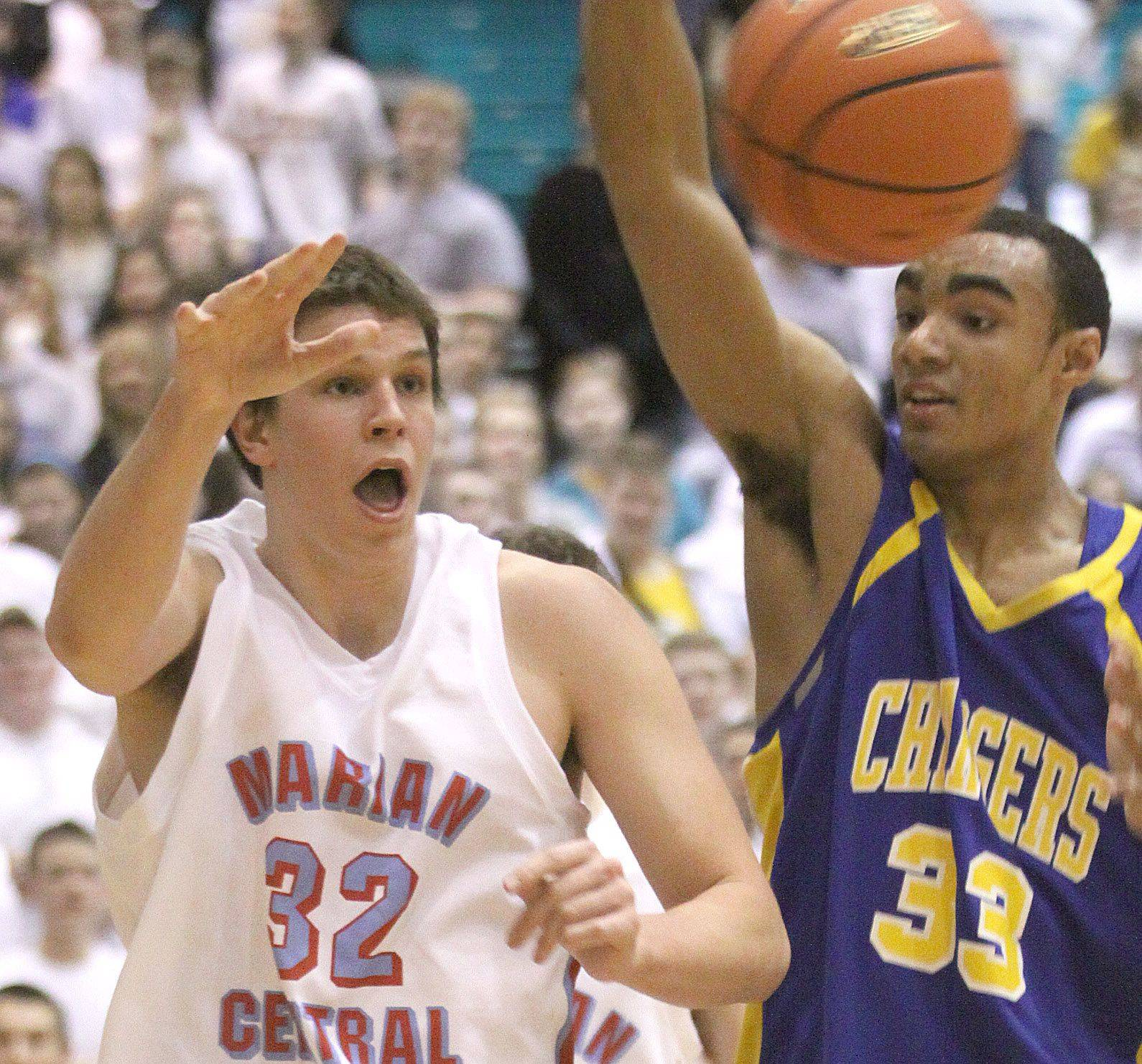 Aurora Central Catholic's Robert DeMyers, right, and Marian Central's Ben Krol scramble for control of a loose ball.