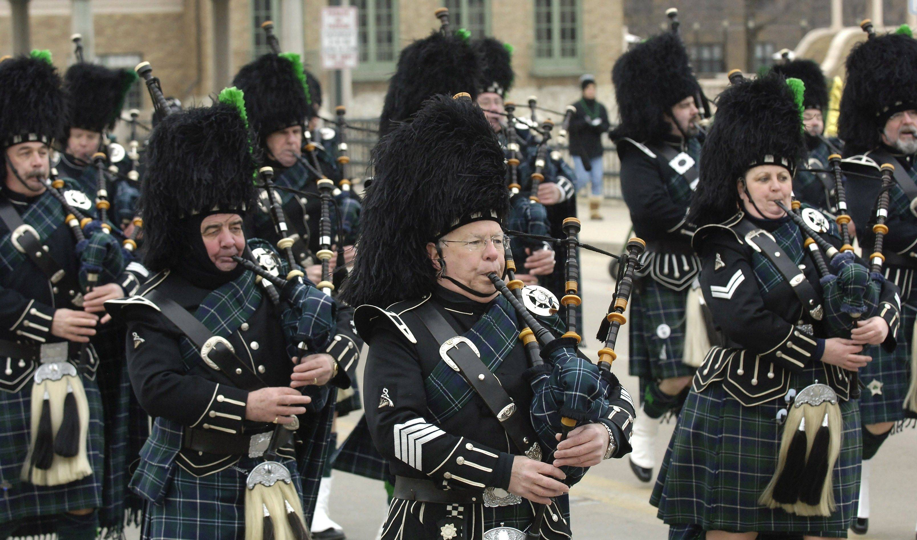 The Bagpipes and Drums of the Emerald Society of the Chicago Police Department make their way over the Fox River Bridge in St. Charles' annual St. Patrick's Day parade.