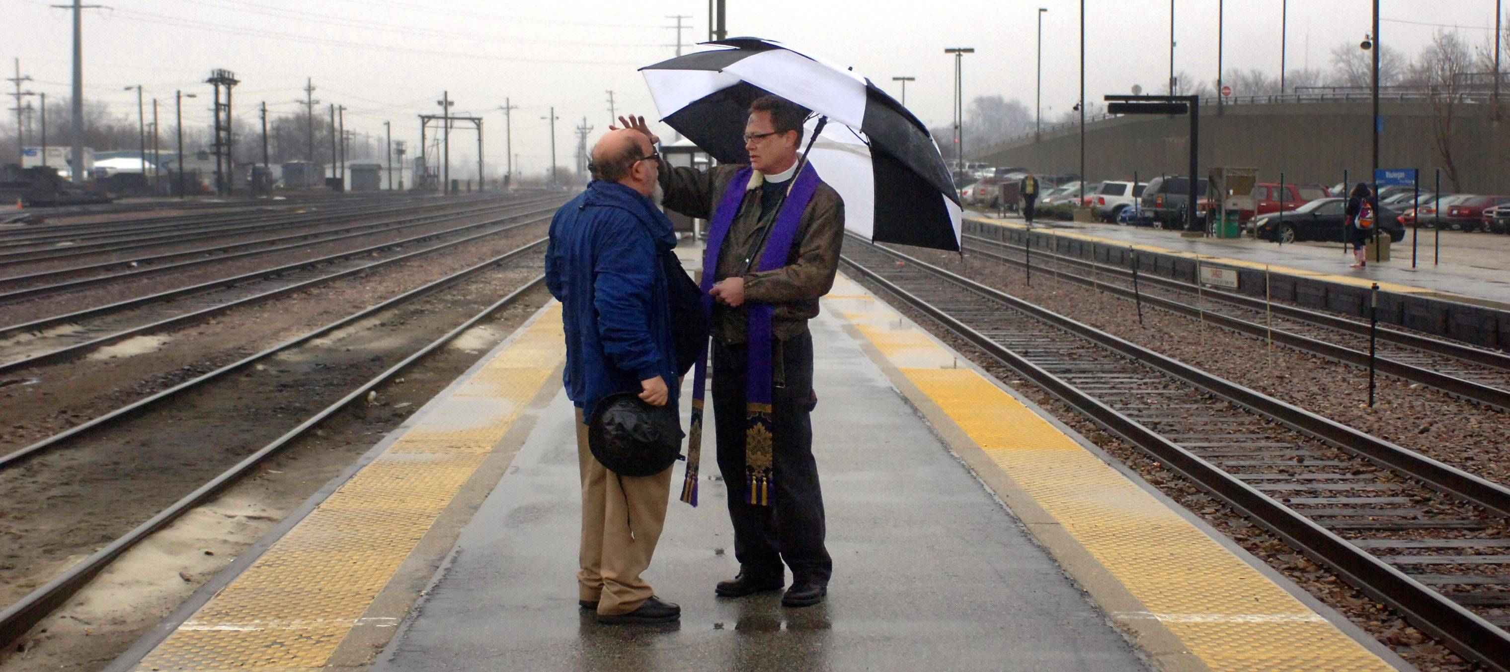 Beach Park resident John Anderson receives ashes from Rev. Clyde Elledge of Annunciation of Our Lady Episcopal Church in Gurnee Wednesday morning at the Waukegan Metra station.