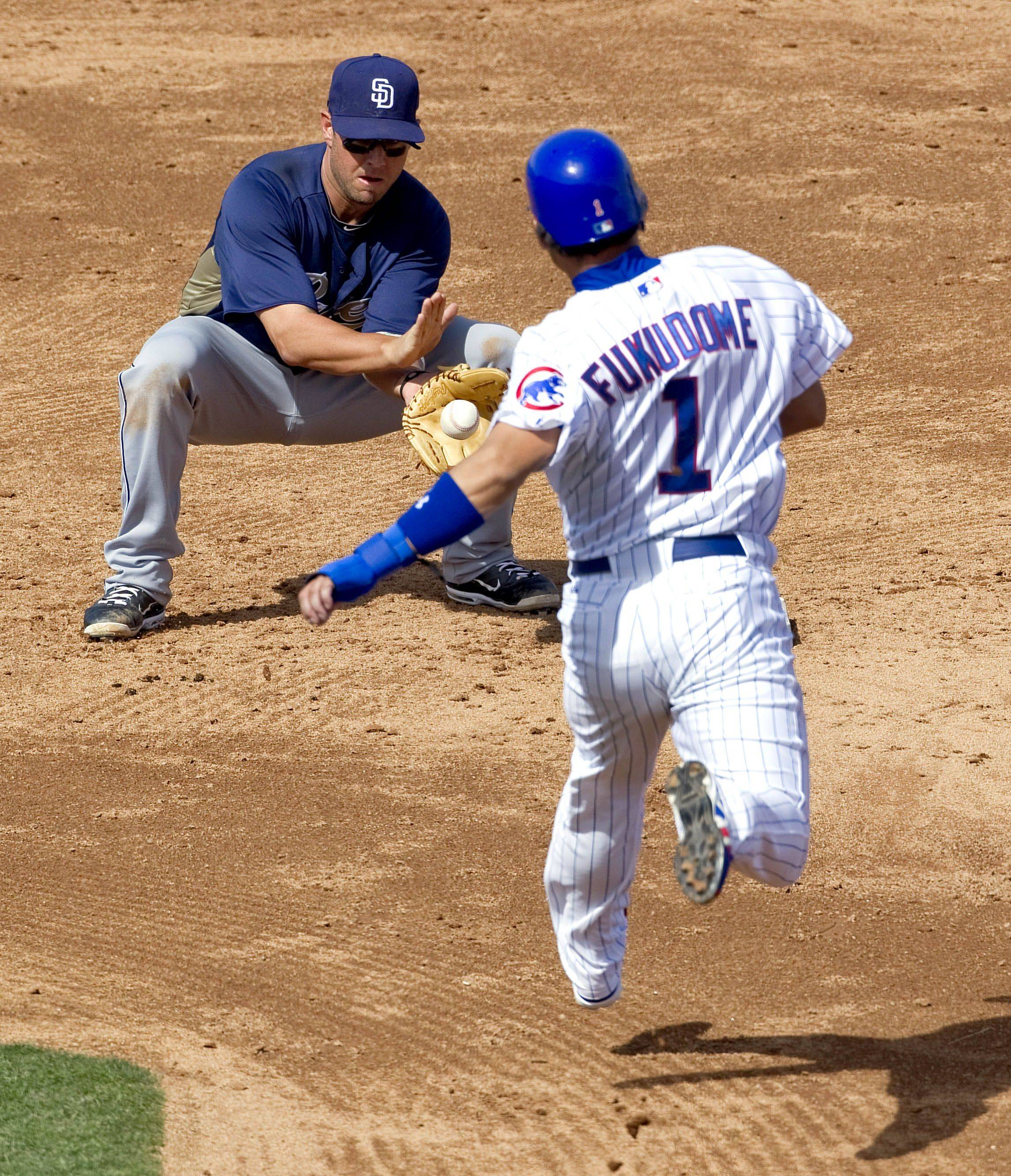 Kosuke Fukudome comes up short in this stolen-base attempt last Saturday against the San Diego Padres. Fukudome is in the last year of a four-year contract with the Cubs.