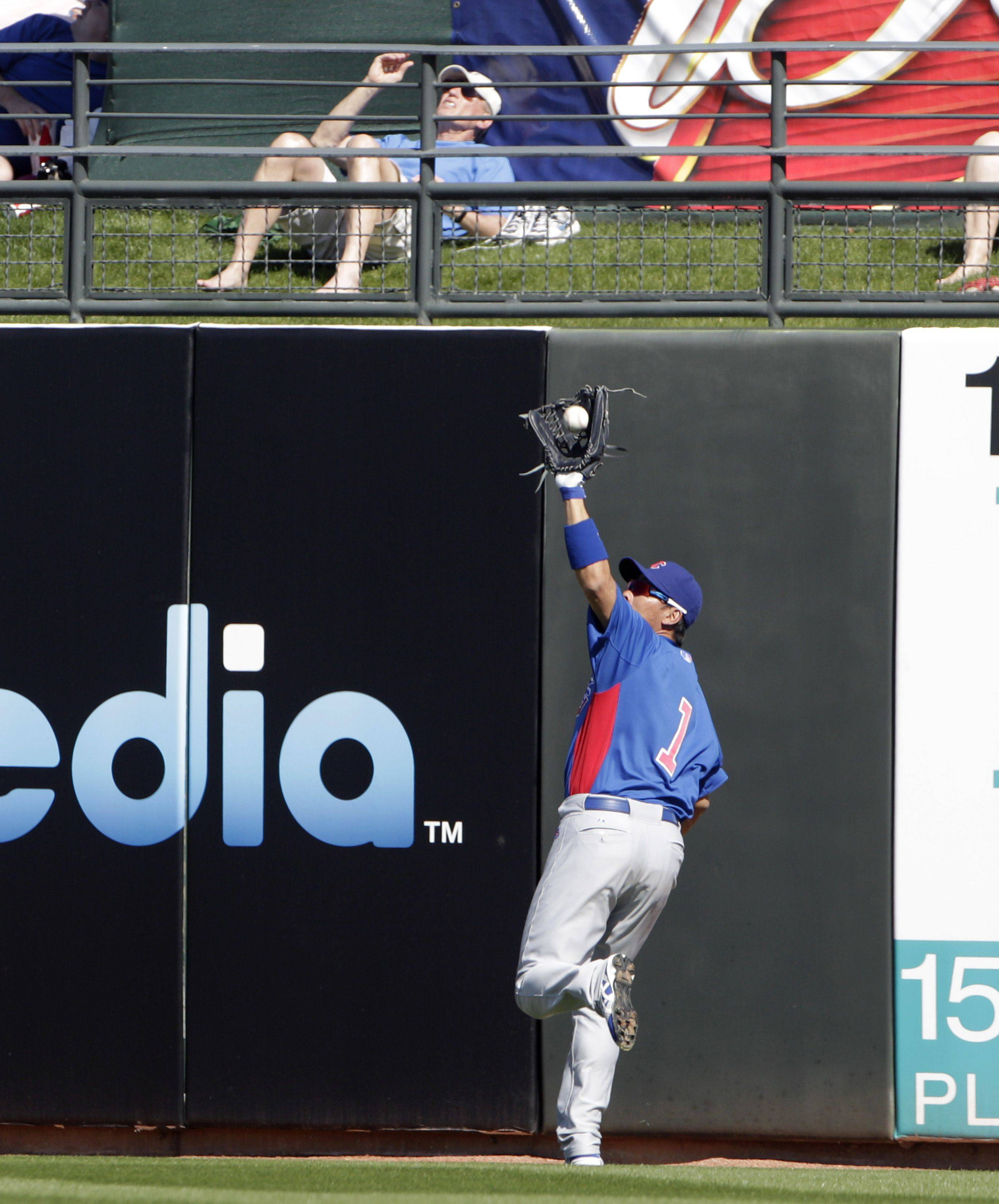 Cubs right fielder Kosuke Fukudome makes a running catch to take a hit away from Kansas City Royals' Mike Aviles last week in their Cactus League game in Surprise, Ariz.