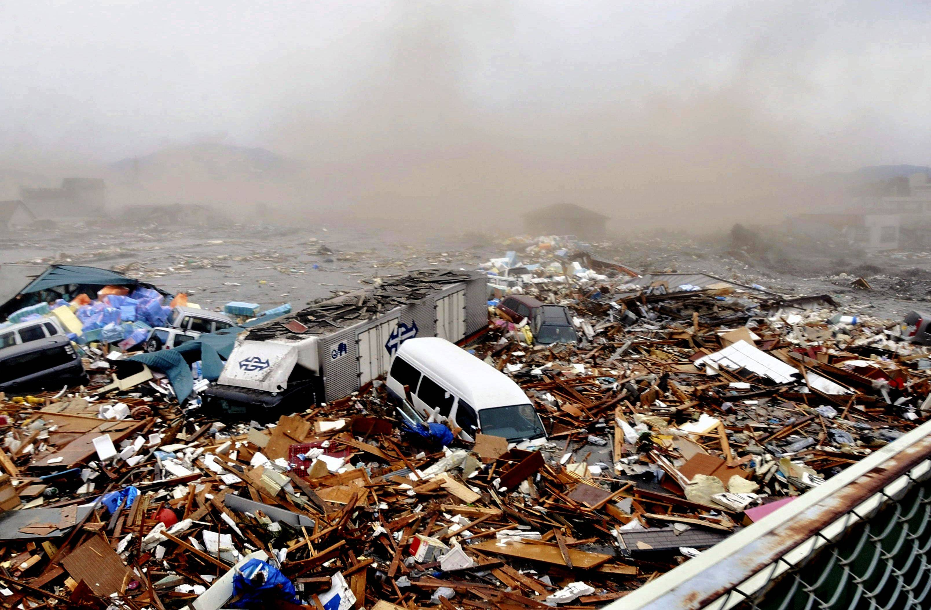 Cars and other Debris swept away by tsunami tidal waves are seen in Kesennuma in Miyagi Prefecture, northern Japan.