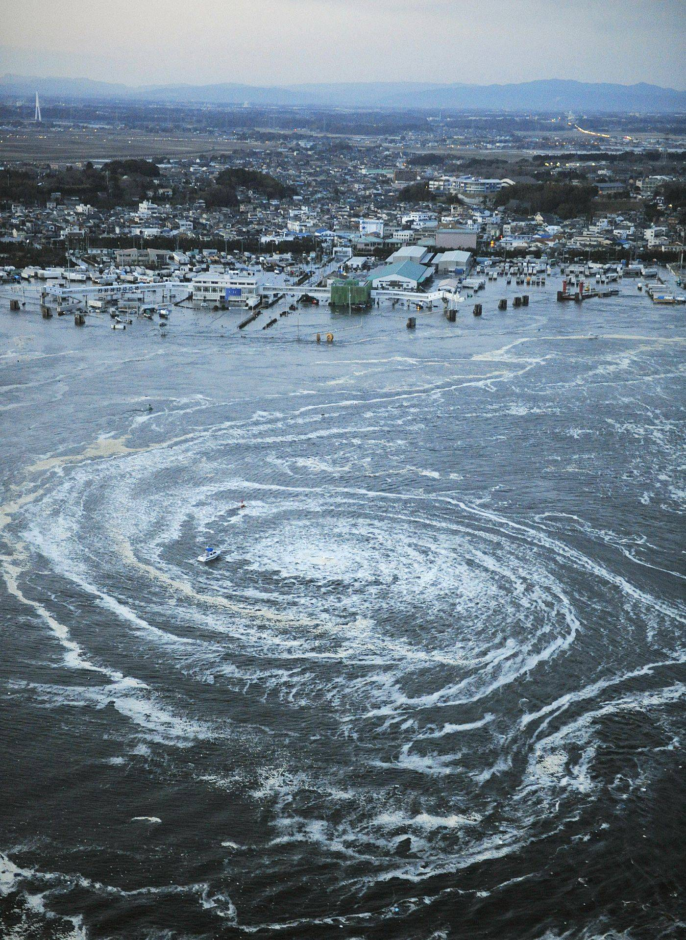 Tsunami swirls near a port in Oarai, Ibaraki Prefecture (state) after Japan was struck by a strong earthquake off its northeastern coast on Friday