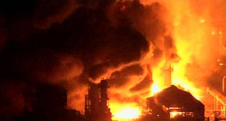 In this video image taken from Japan's NHK TV, an oil refinery burns in Ichihara, Chiba Prefecture Japan Friday.